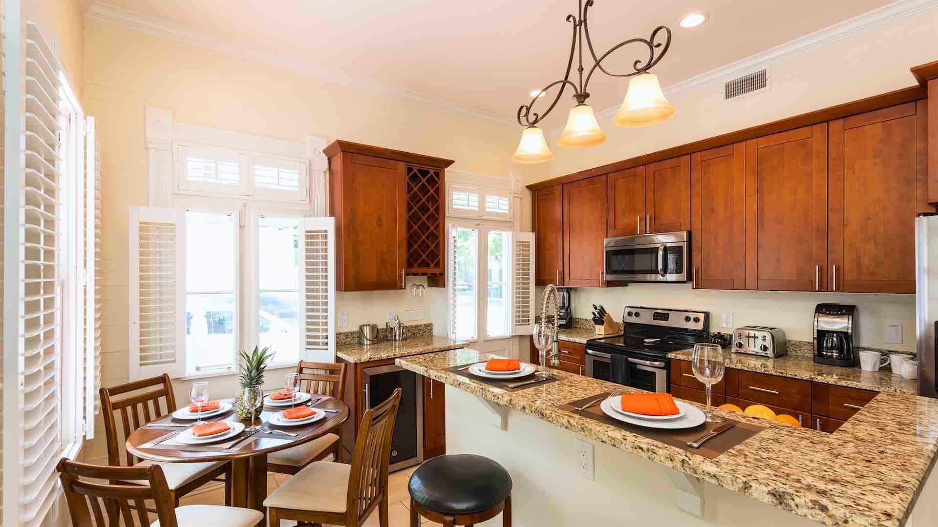 The downstairs condo has an open kitchen and dining area...