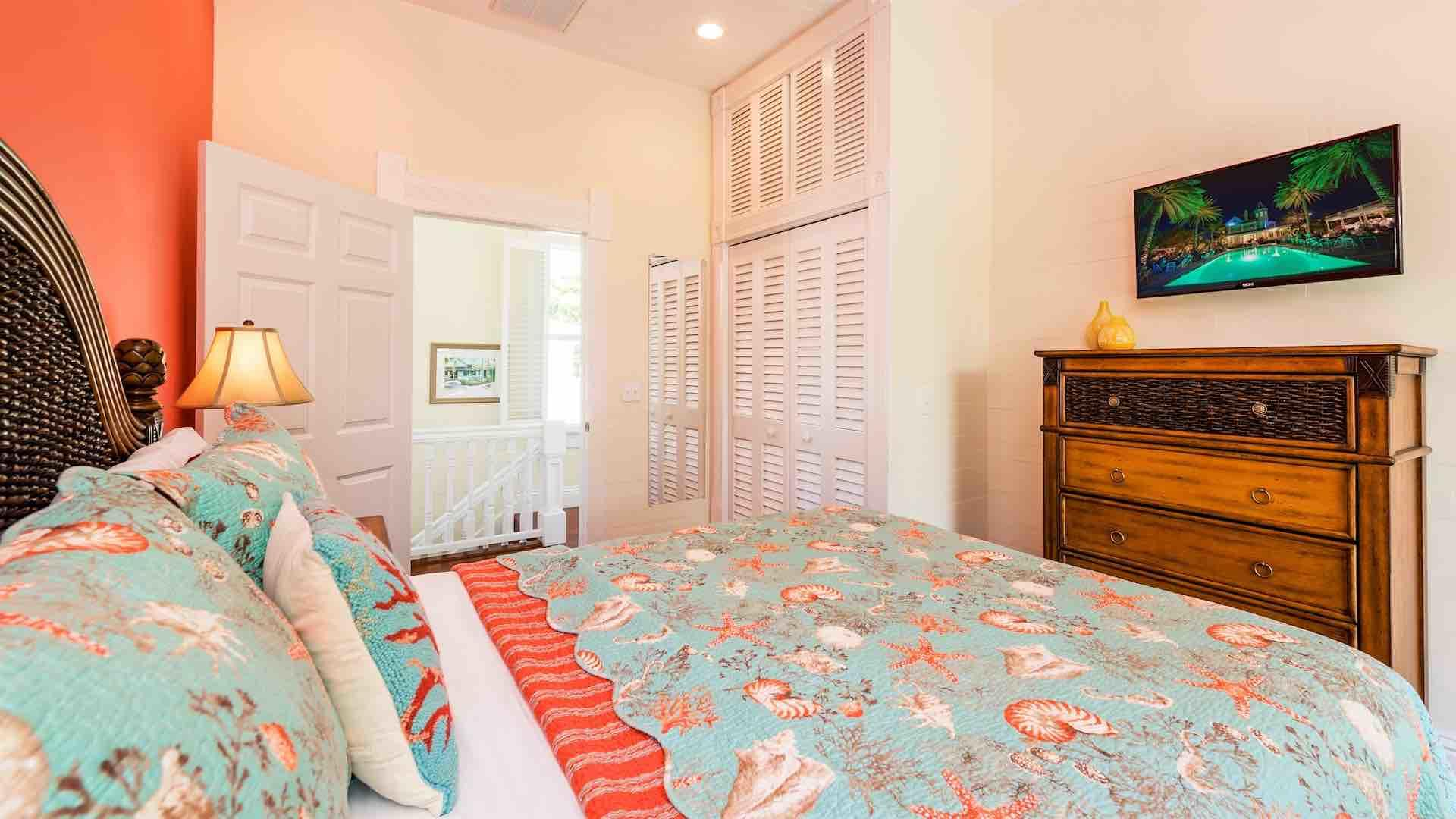 The second upstairs bedroom also has a Queen bed and flat screen TV...