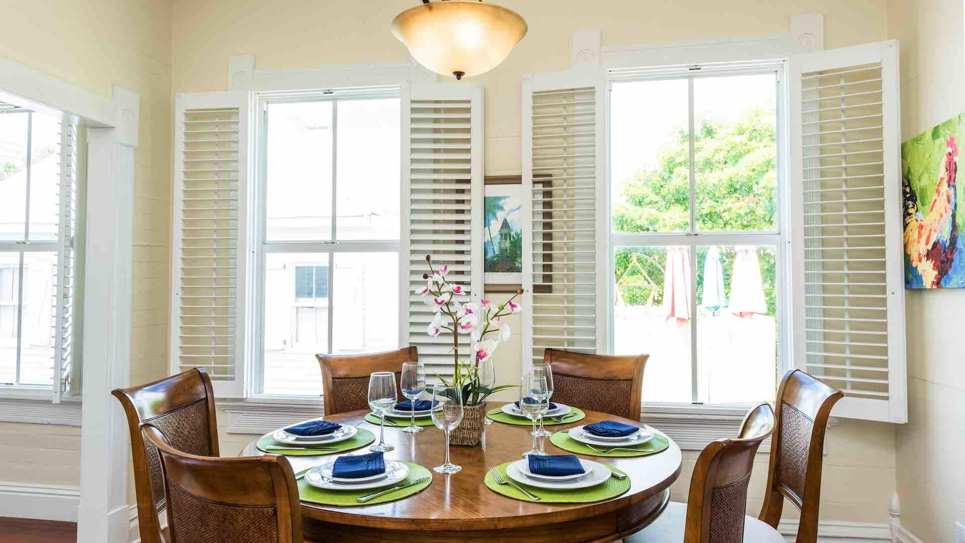 The upstairs condo has a dining table that seats six...