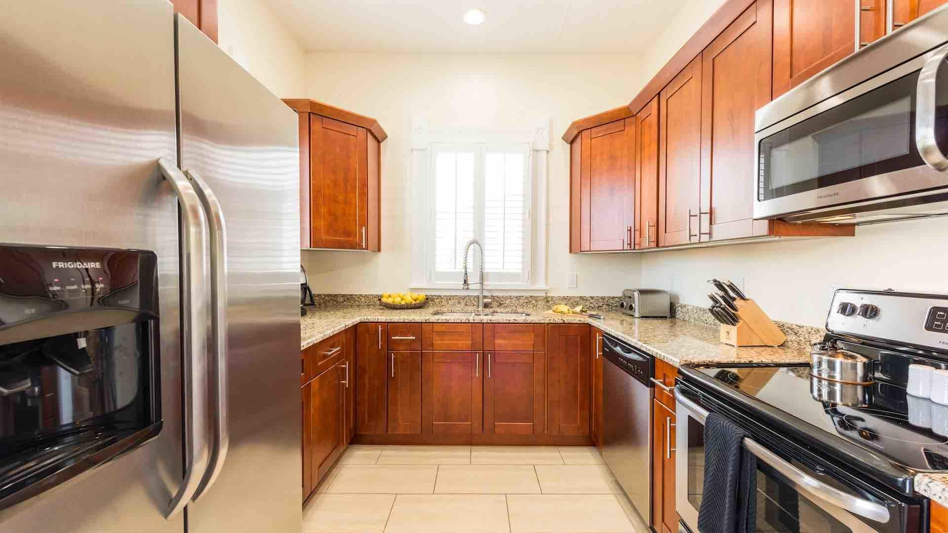 The upstairs condo has a fully equipped kitchen, with stainless steel appliances...
