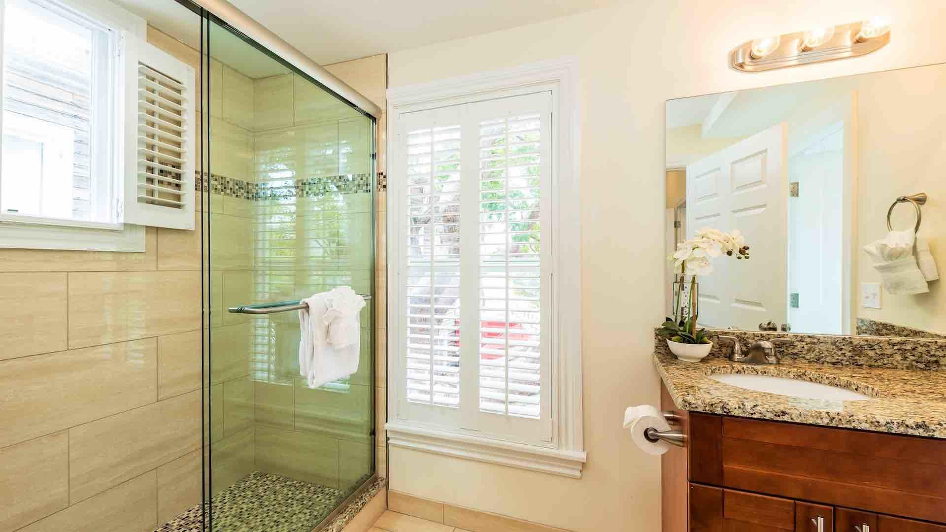 The upstairs master bathroom has a walk-in glass shower...