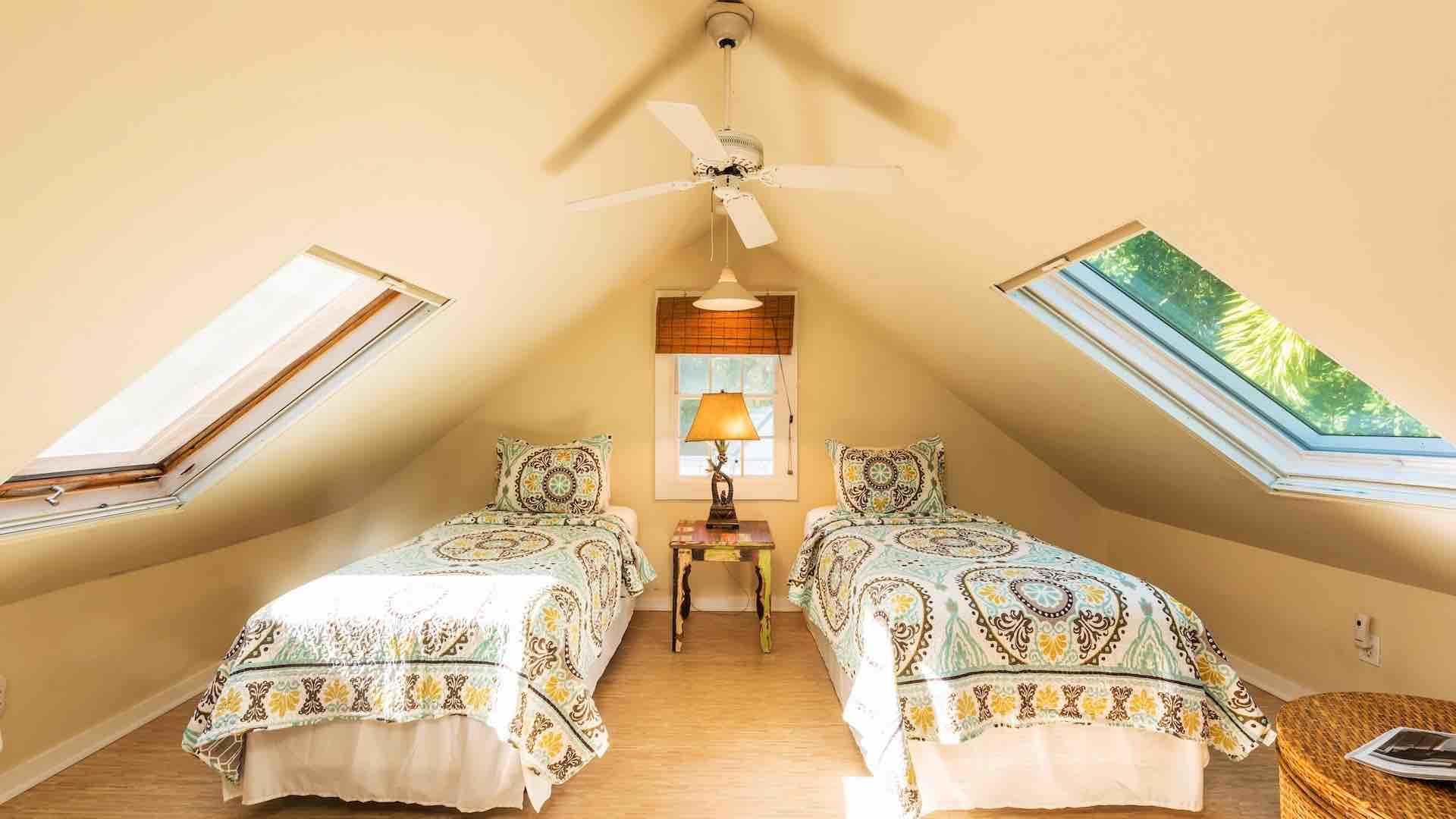 The third bedroom has four large windows with retractable blinds and two fans...