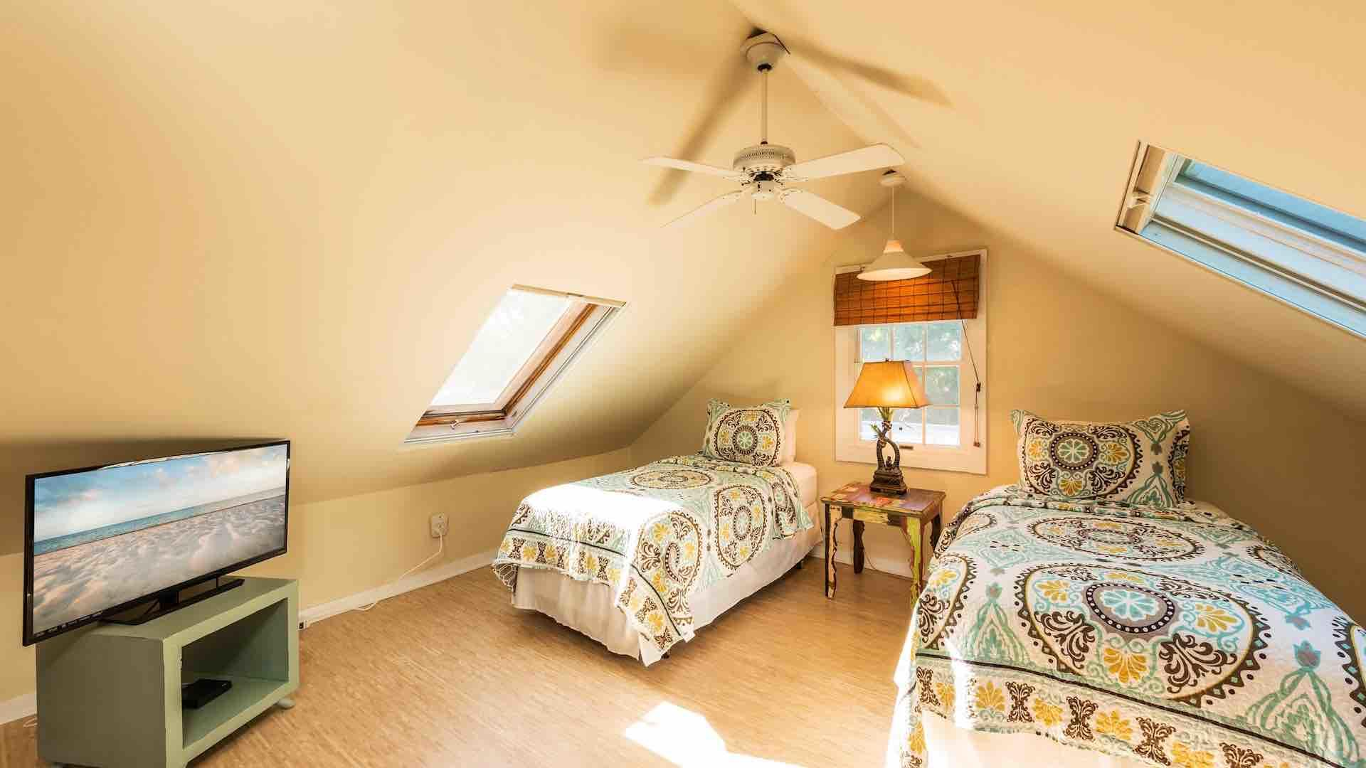 The third bedroom has two twin beds that convert to a King, and a flat screen TV...