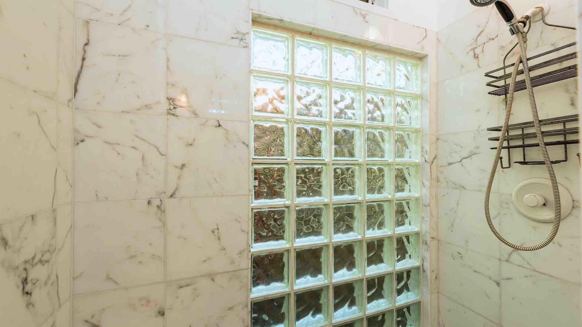 The master bathroom has a large custom tiled shower...
