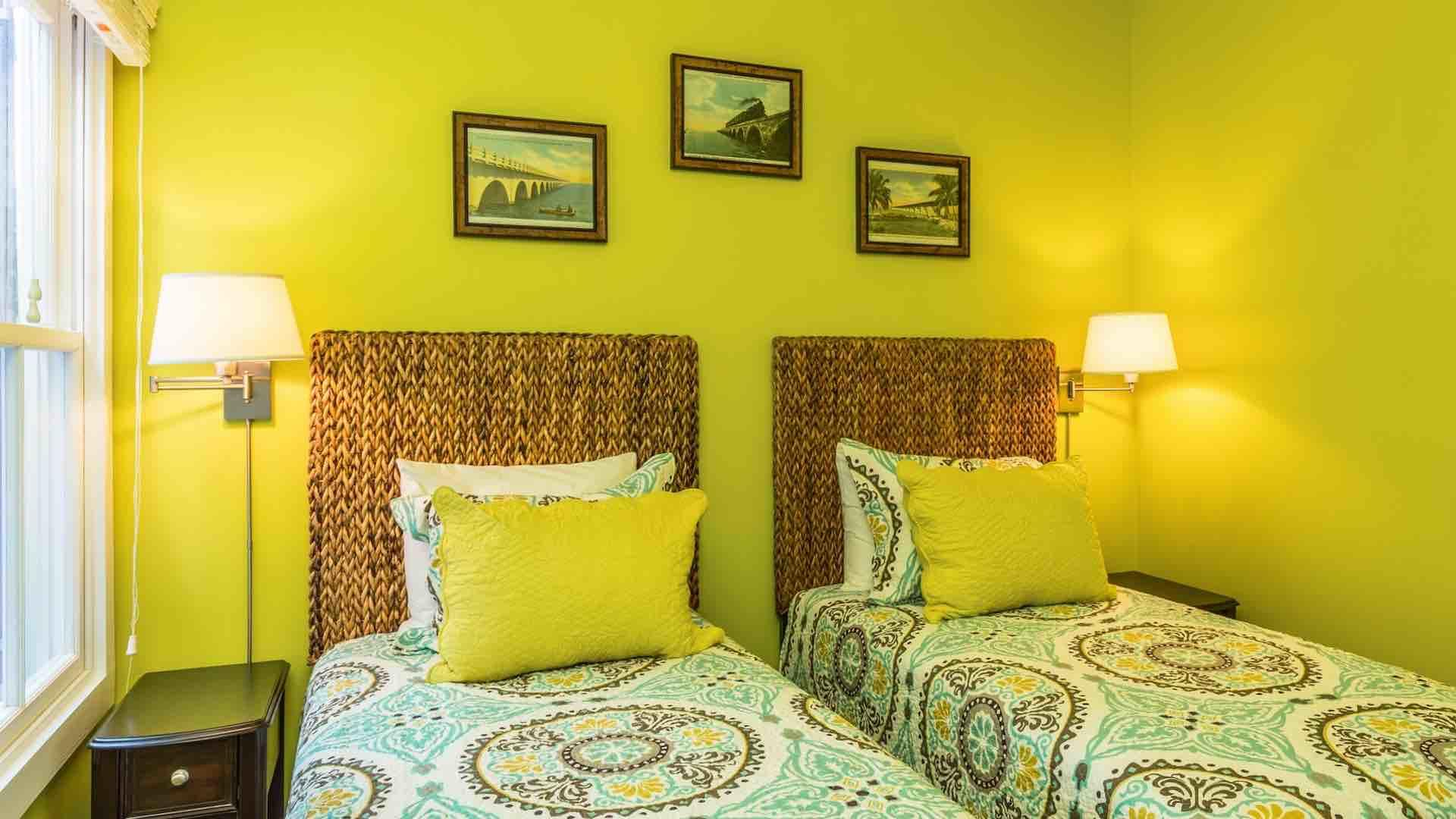 Each bed has its' own reading lamp and nightstand...