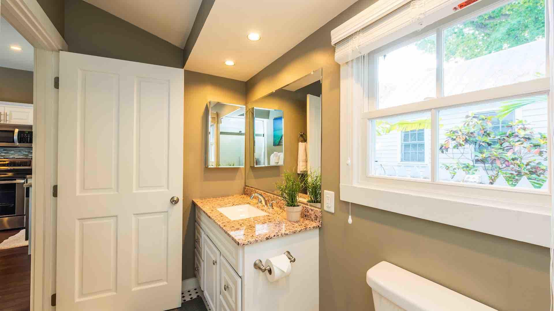 The guest bathroom is located off the living room...