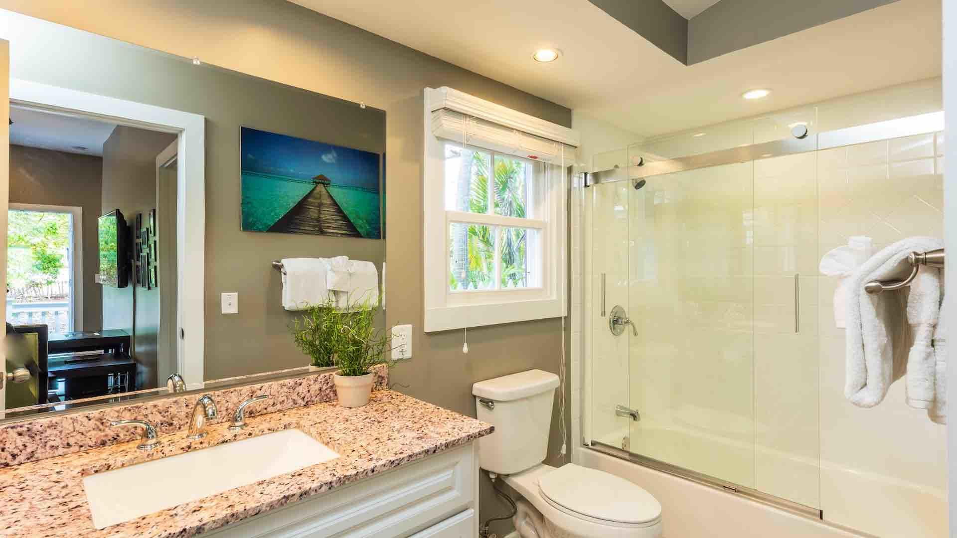 The guest bathroom has a shower and tub combo...