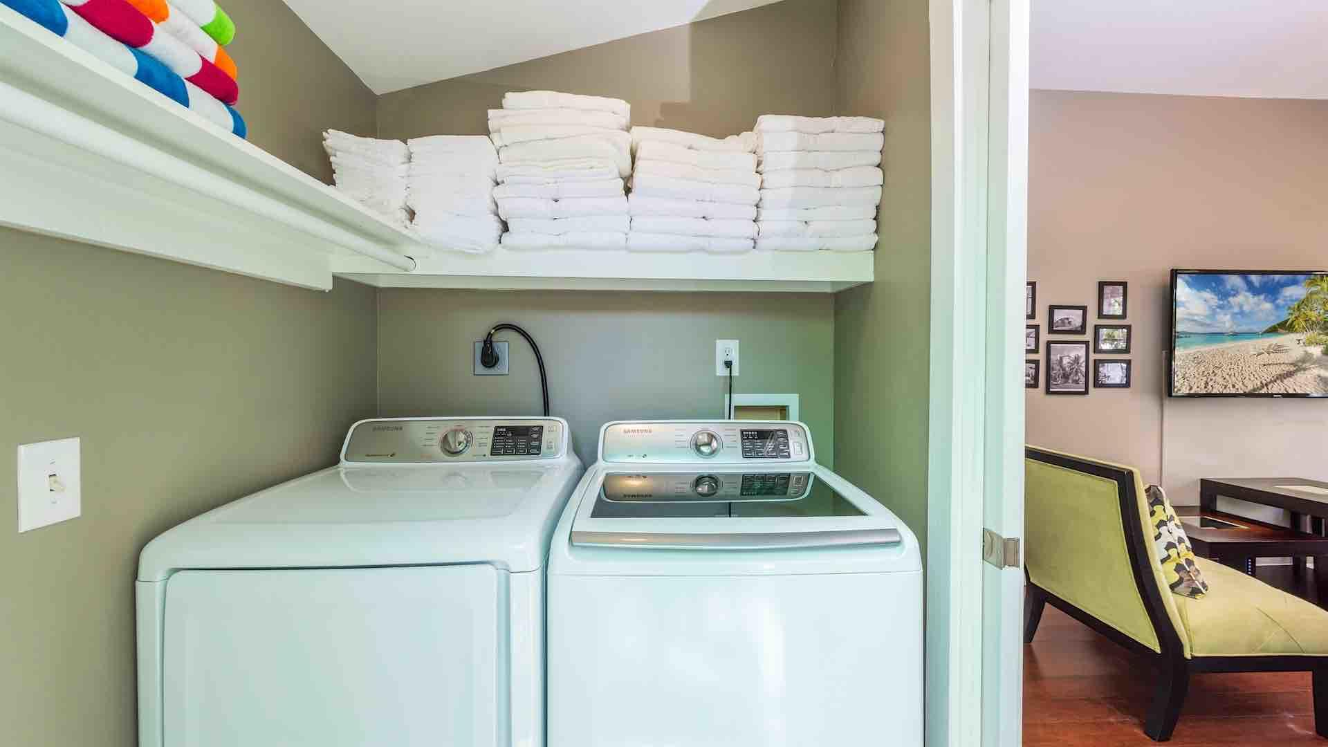 The laundry room has a washer and dryer, as well as extra towels...
