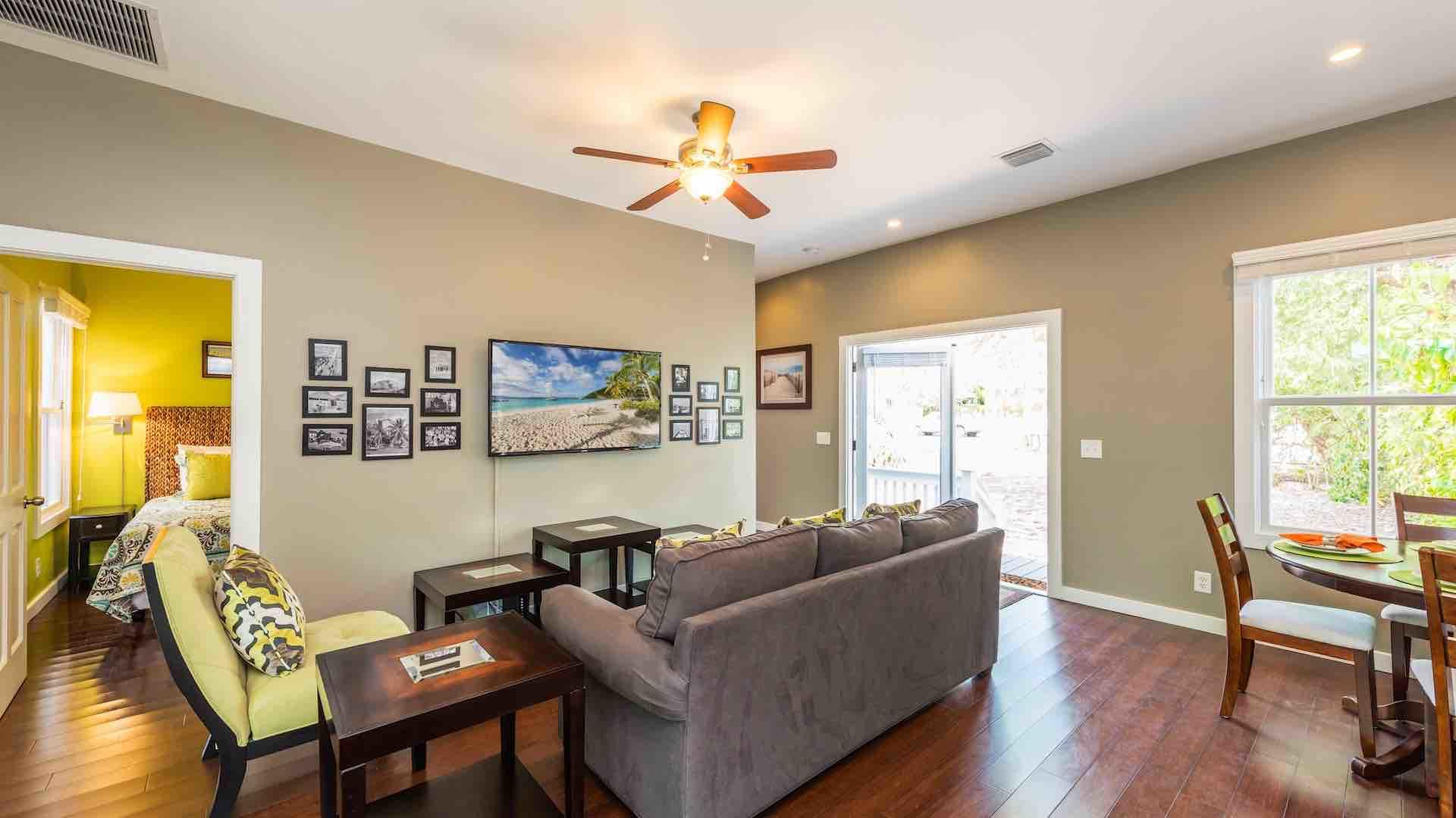 You'll enter the home through the side French Doors into the living room...