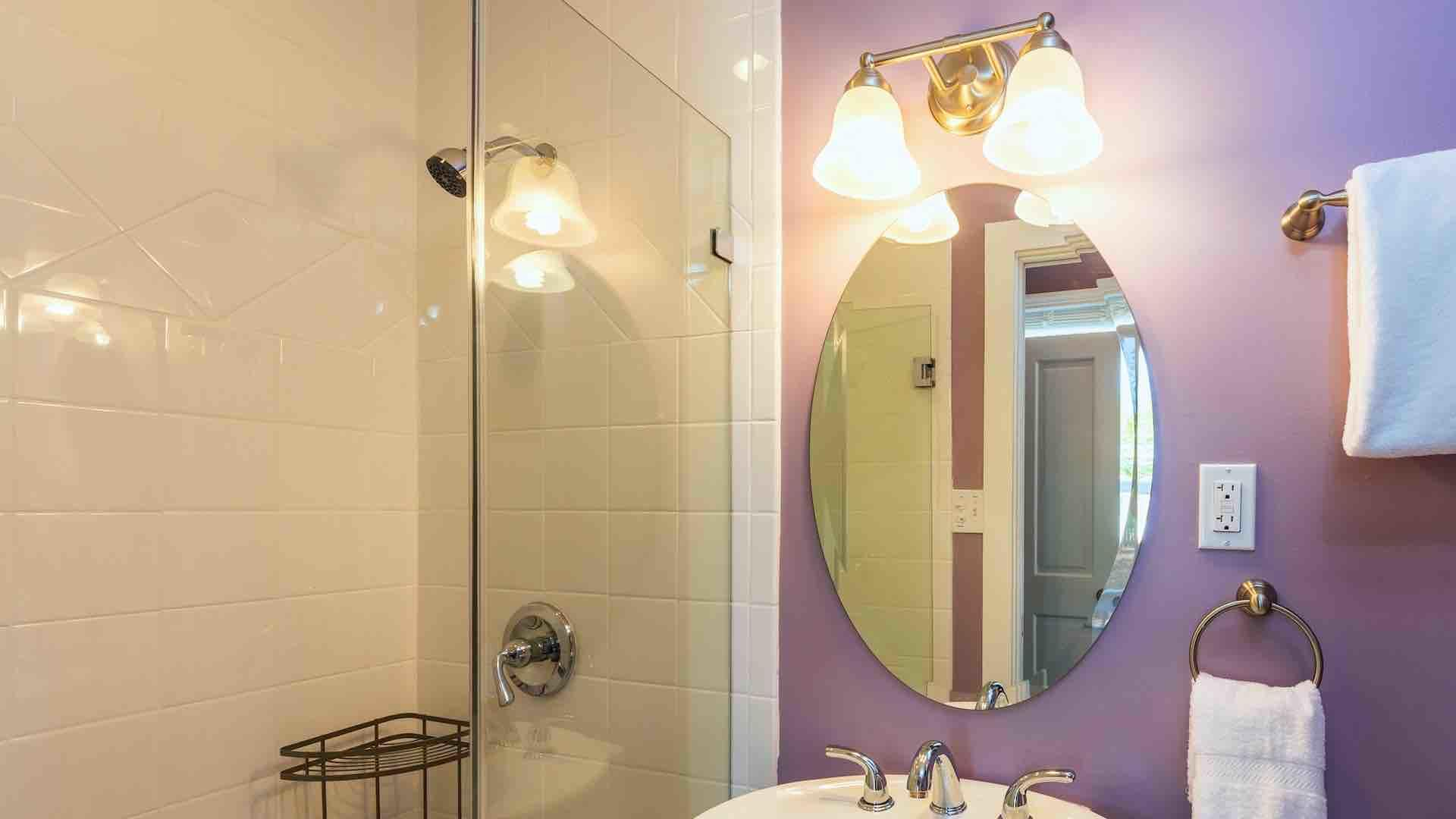 The master bathroom has a walk-in glass shower...