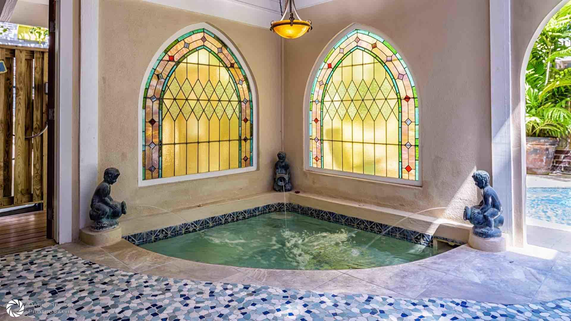There is a grotto-style spa under the covered lanai...