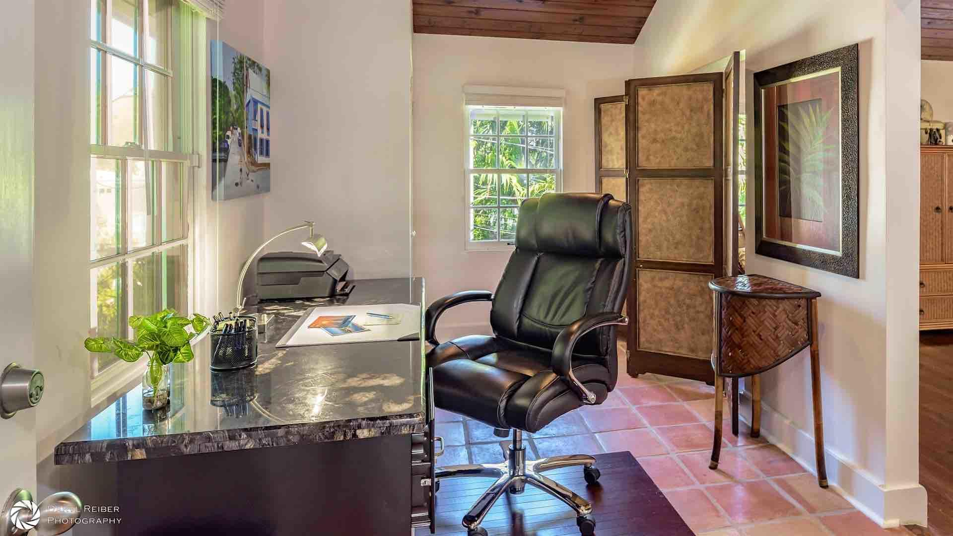 Located in the third bedroom is an Office space with it's own TV...