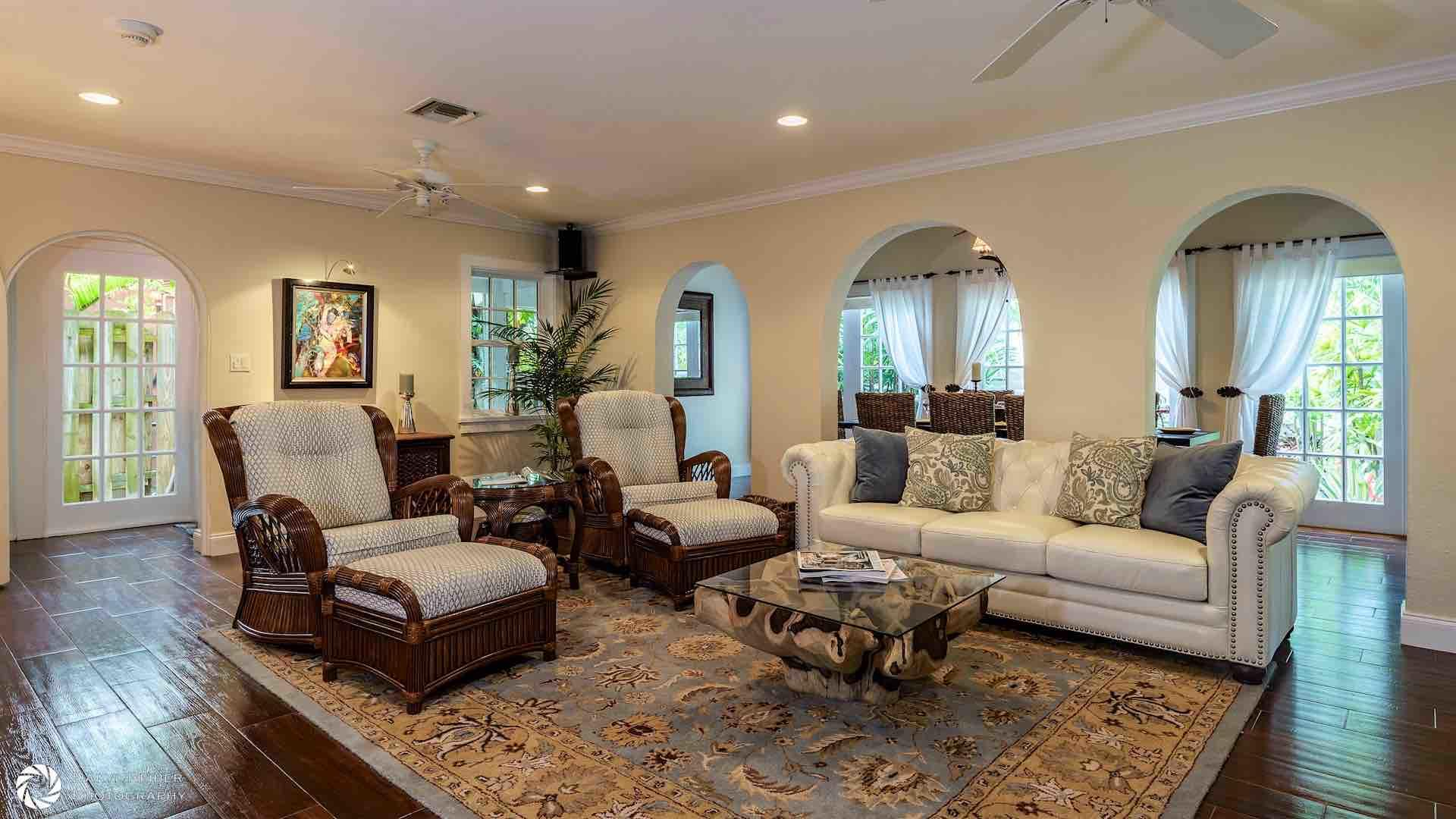 The spacious living room has plenty of comfortable seating for everyone...