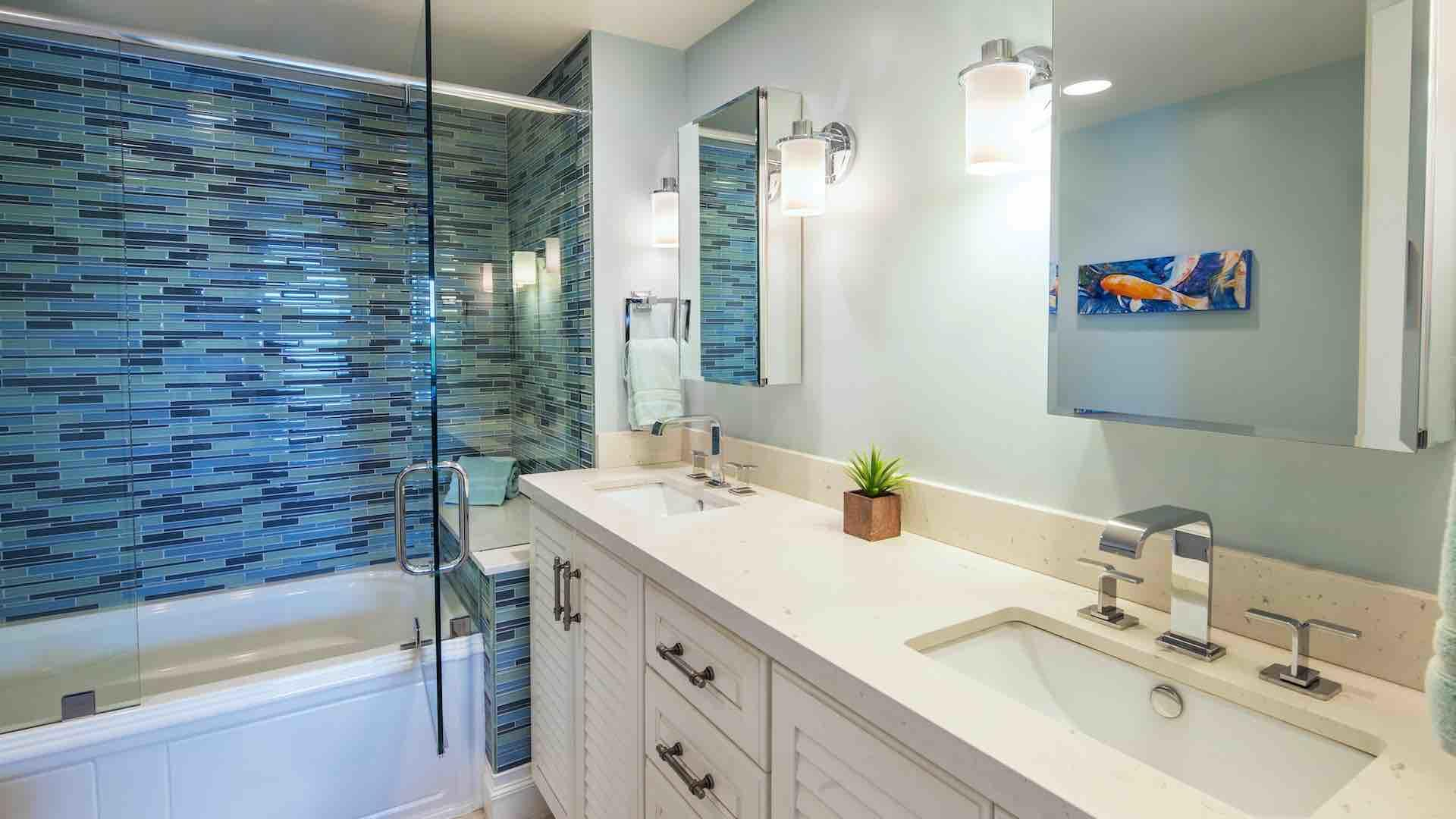 The en suite master bathroom has a shower and tub combo...