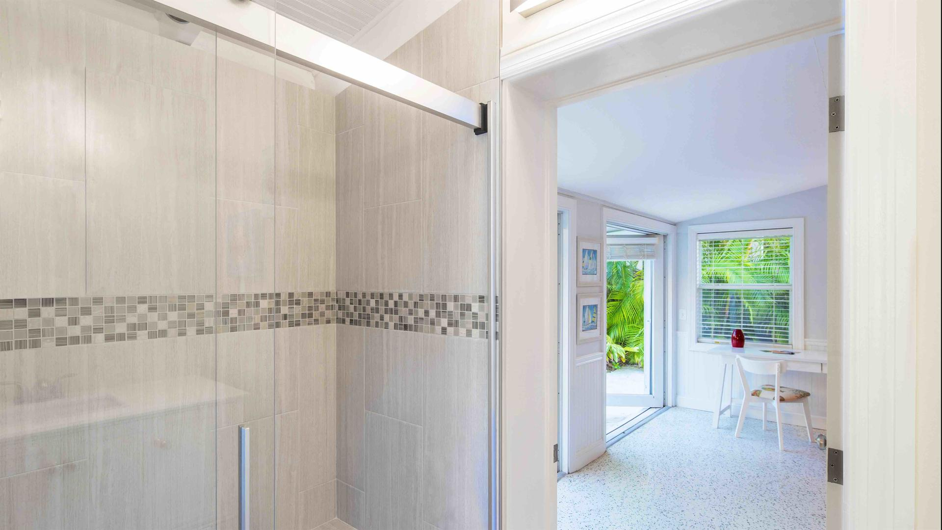 The second bathroom has a large glass shower...