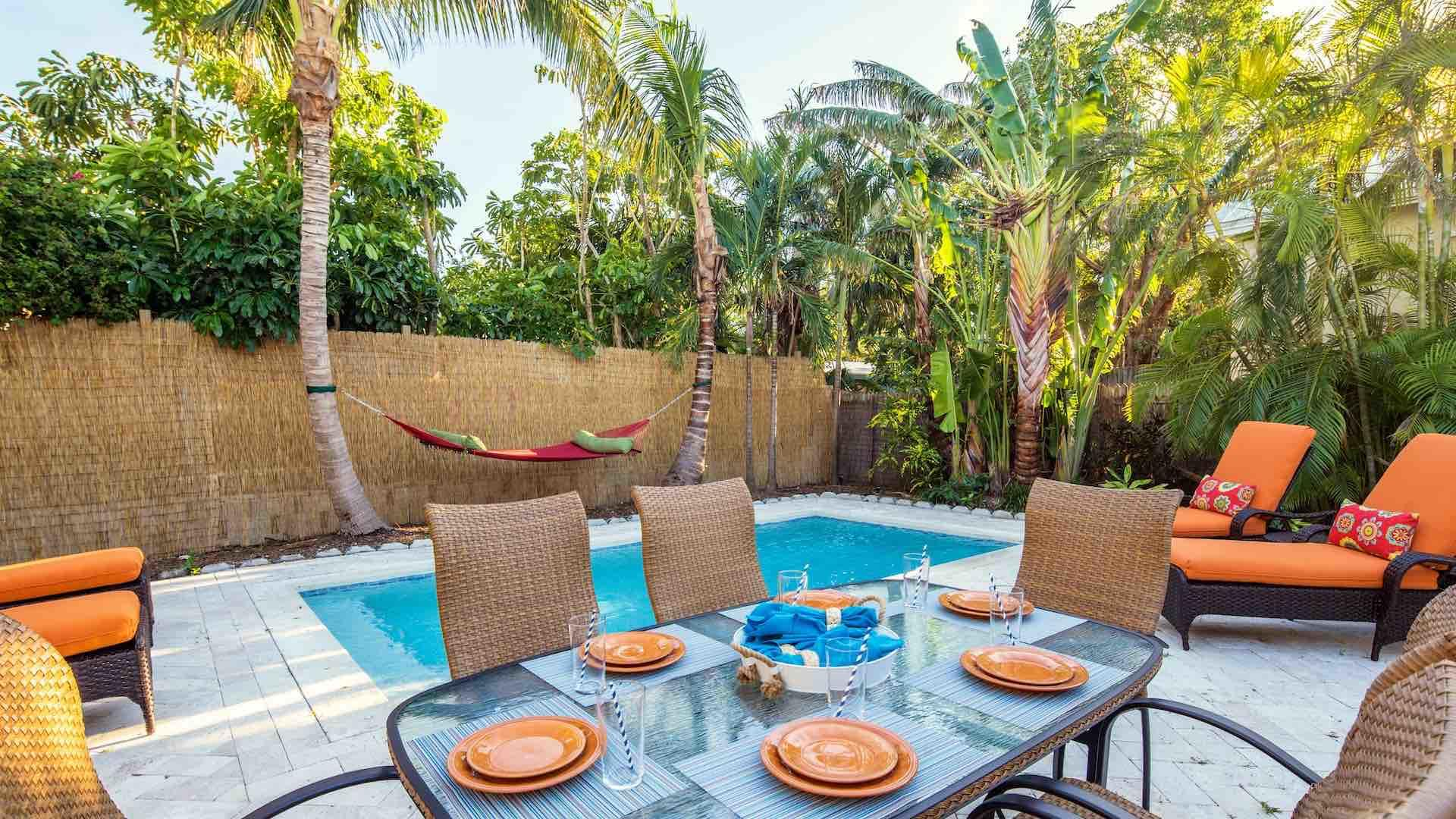 Enjoy a poolside meal using the outdoor dining table, which seats six...