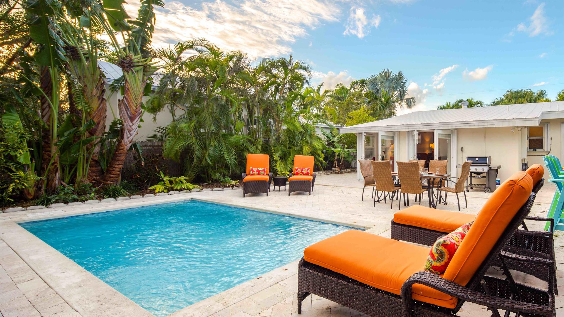 The heated pool is surrounded by chaise lounges...
