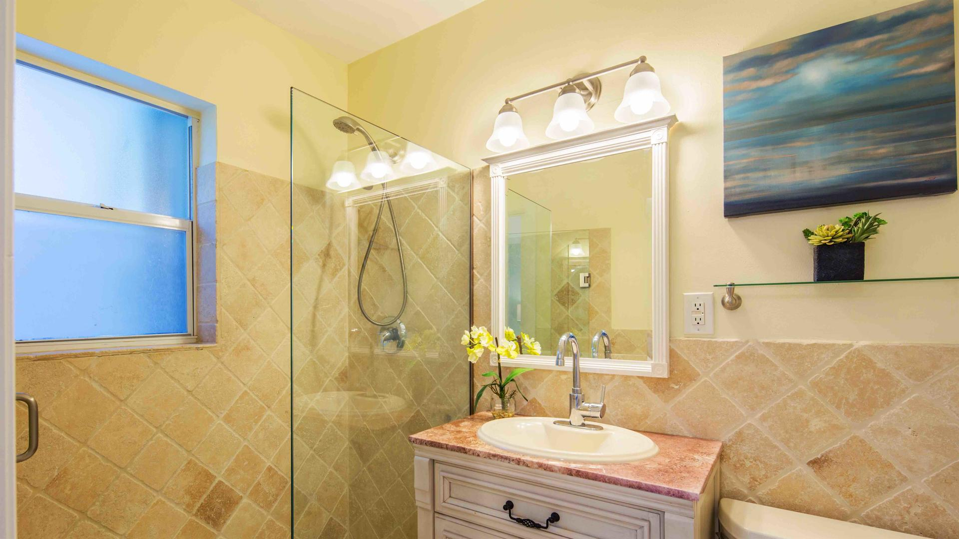 The master bathroom is en suite and has a large glass shower...