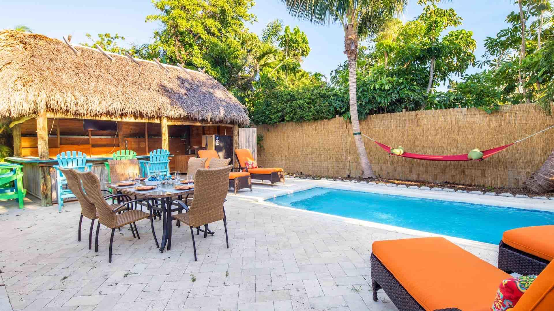 There is plenty of outdoor lounging and seating options around the pool...
