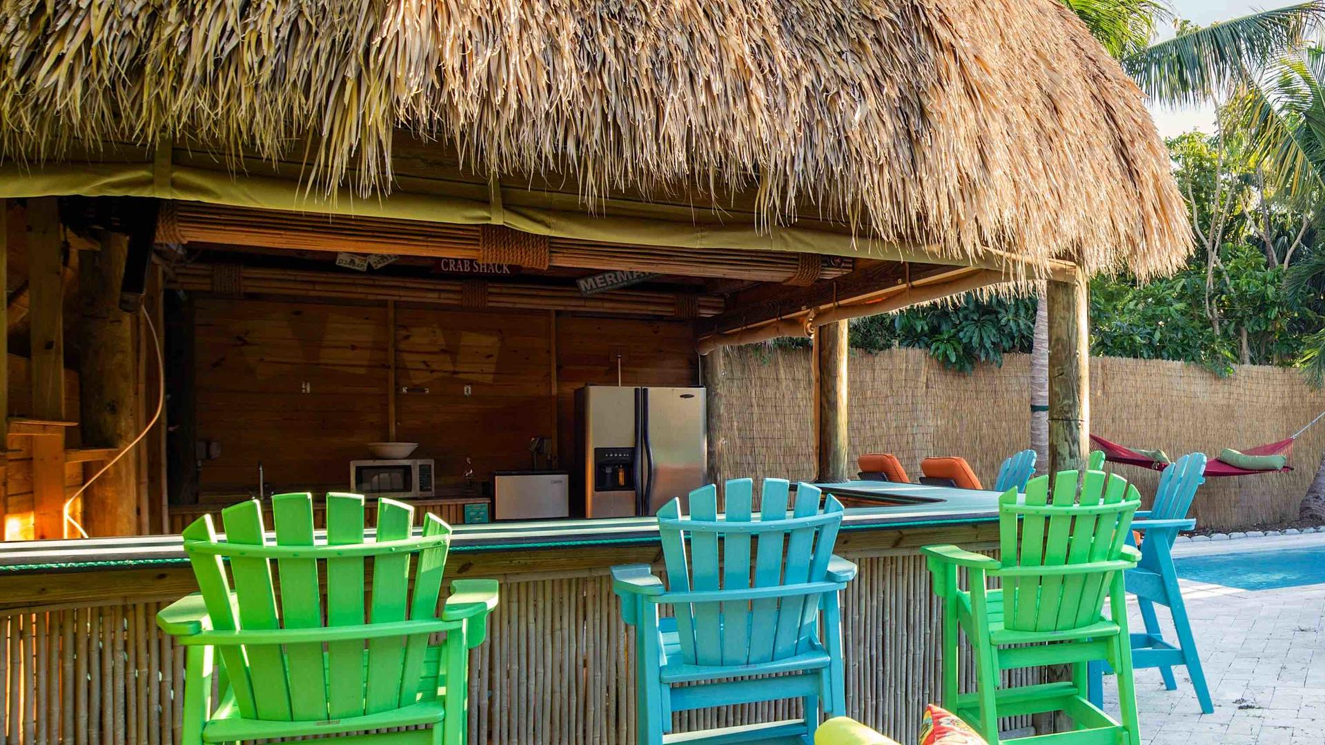 The Tiki Hut has bar seating, a fridge, and a microwave...