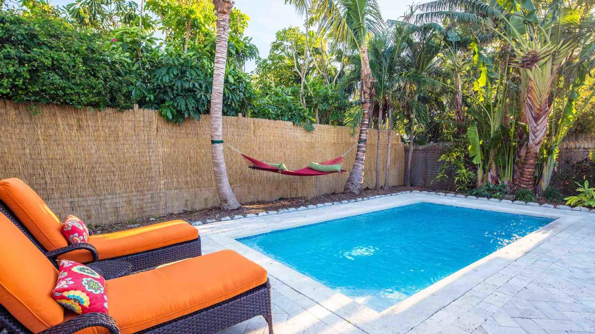 The back yard is completely private and surrounded by lush vegetation...
