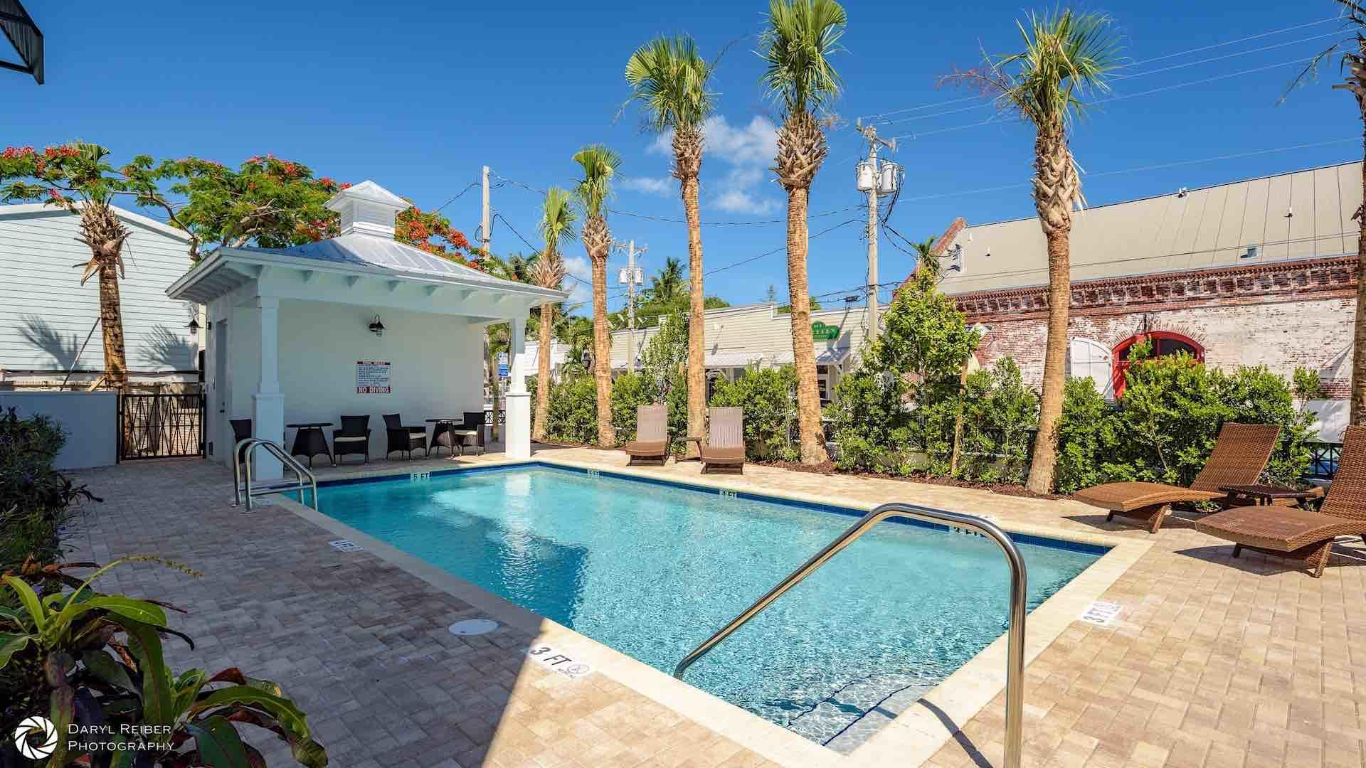 The Community Pool has chaise lounges and a Cabana with bathrooms...