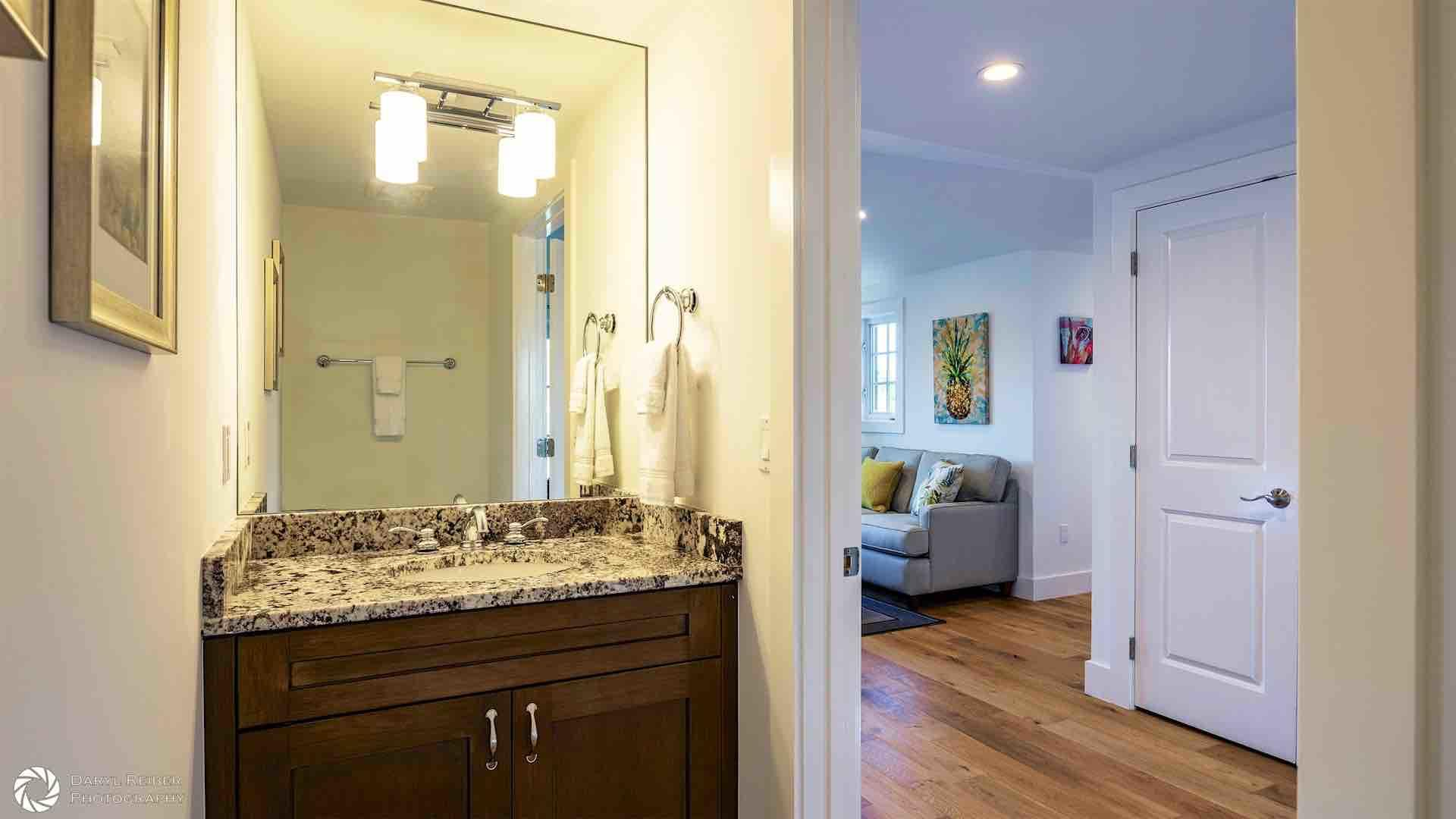 A convenient powder room is located just off of the living room...