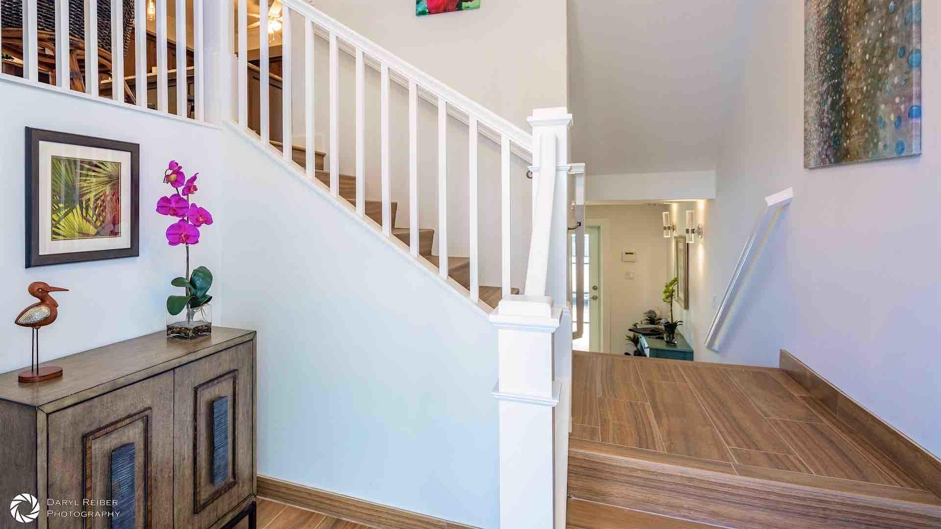 The entry foyer allows you to take the private elevator or the stairs...