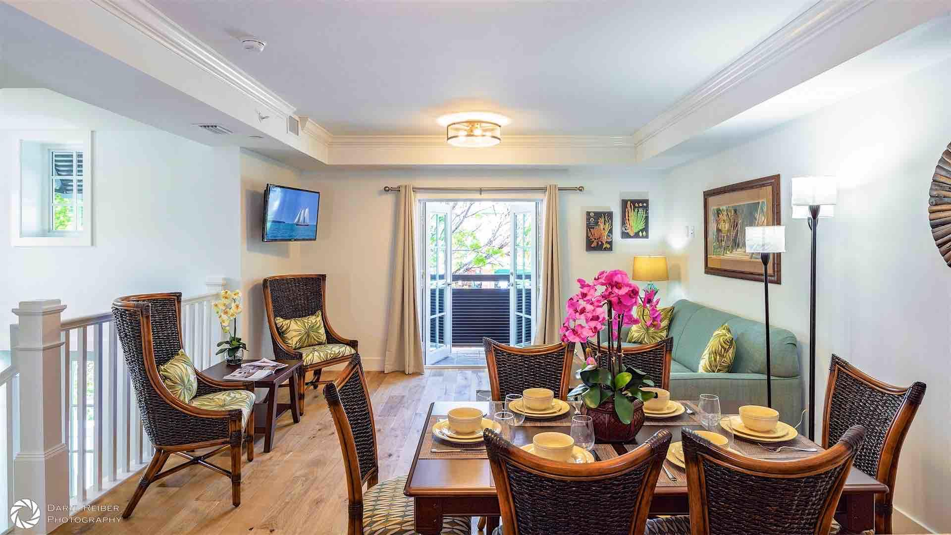 On the second floor, you'll find the sitting room, dining area, and another balcony...