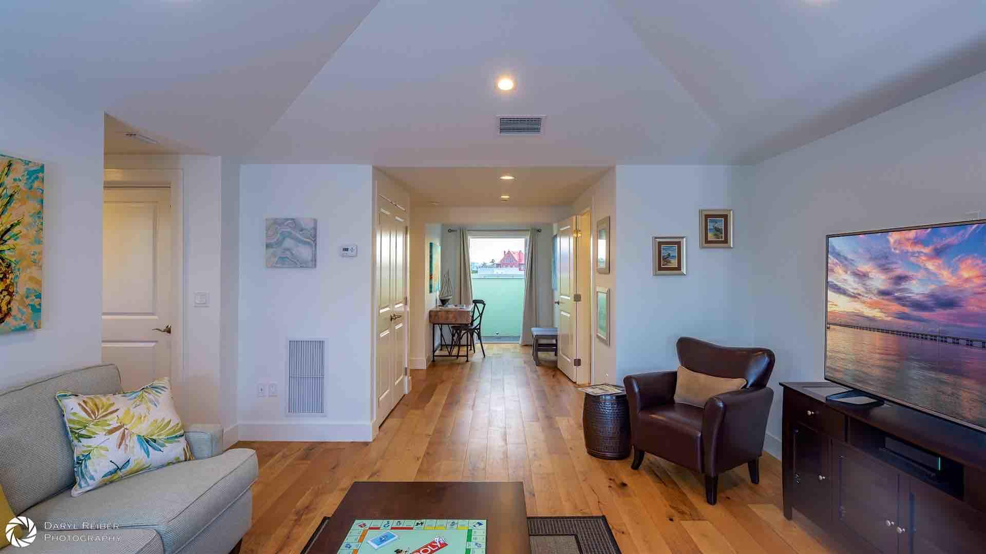 The fourth floor living room has 9 foot high ceilings and plenty of space for everyone in your group...