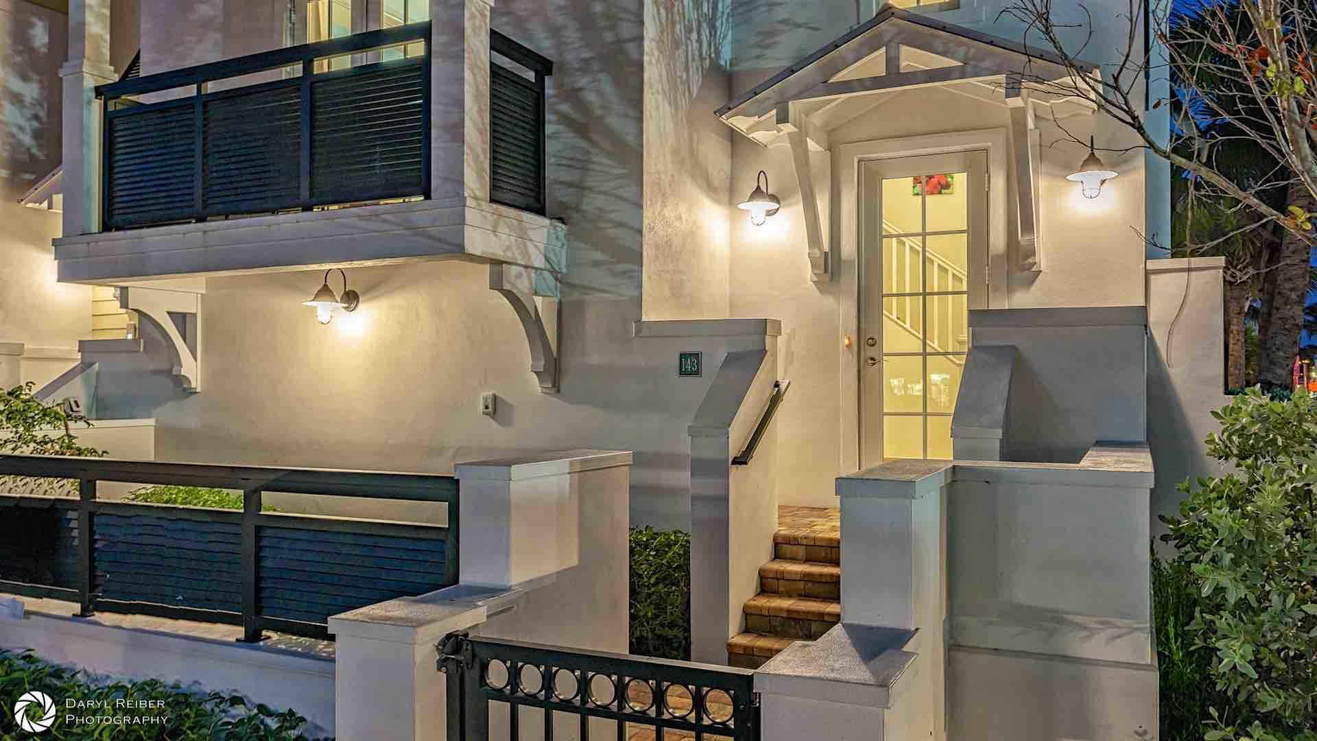 The front entrance to Heart of the Harbor is on Simonton Street, with a cozy front porch...