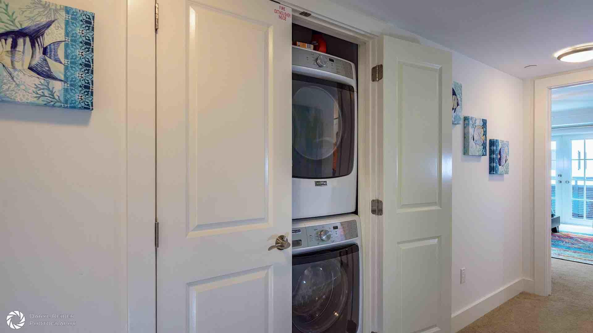 The laundry closet, including a stackable washer and dryer, is located on the third floor hallway...