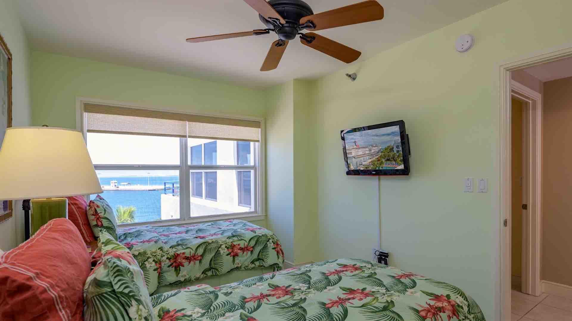 The second bedroom also has views of the ocean, overhead fan and flat screen TV...