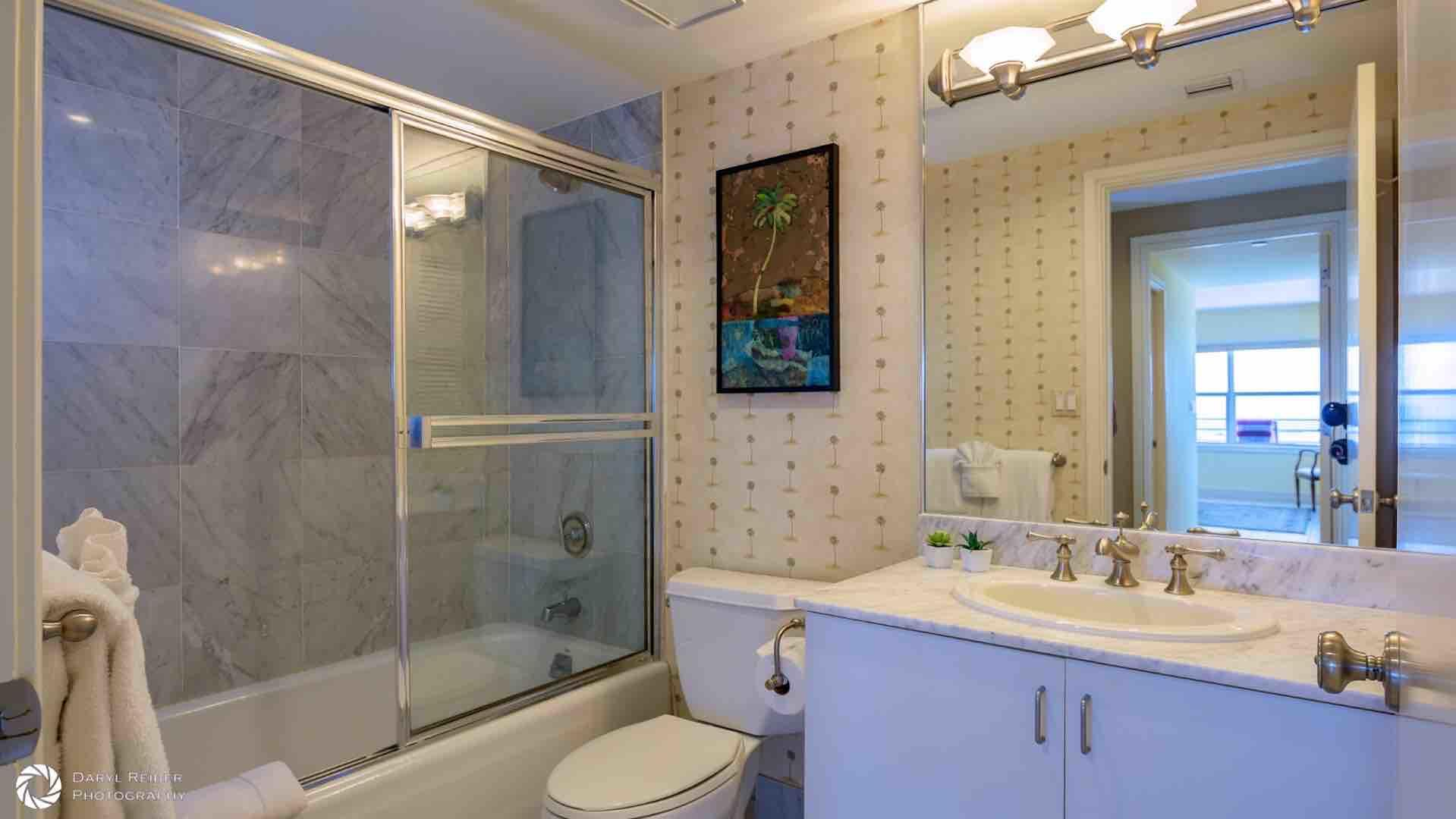 The second full bathroom is right across from the bedroom with tub and shower...