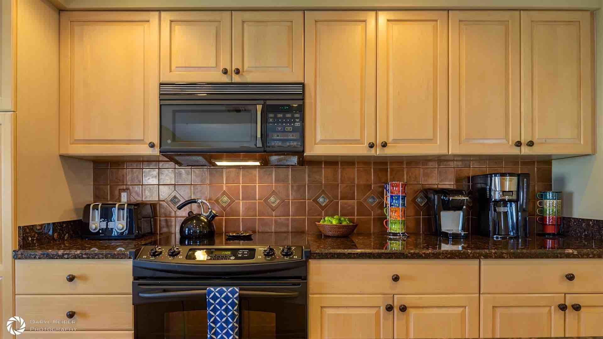 The kitchen has plenty of counter and cabinet space...