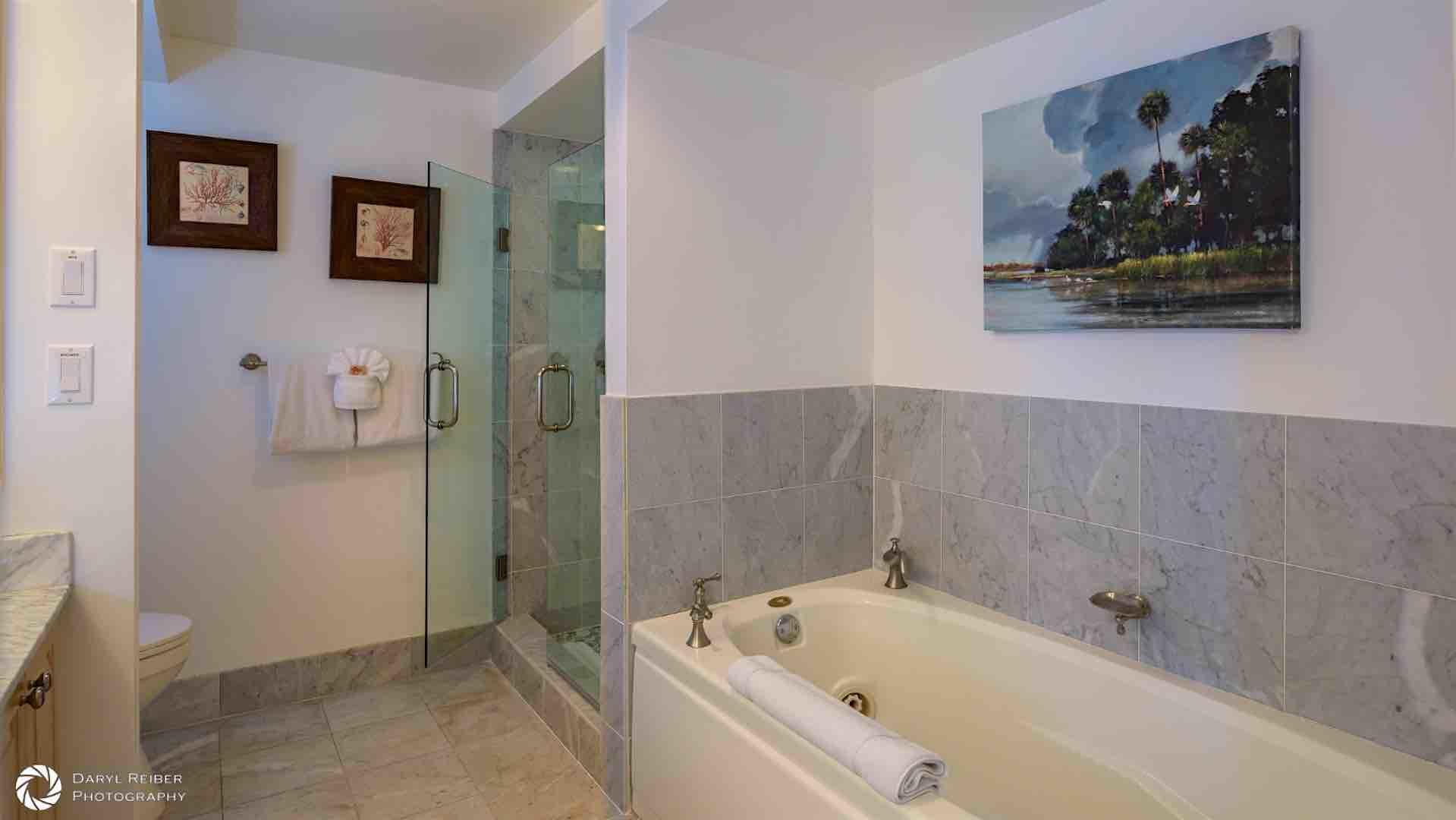 The master bathroom offers both a Jacuzzi and a large glass shower...