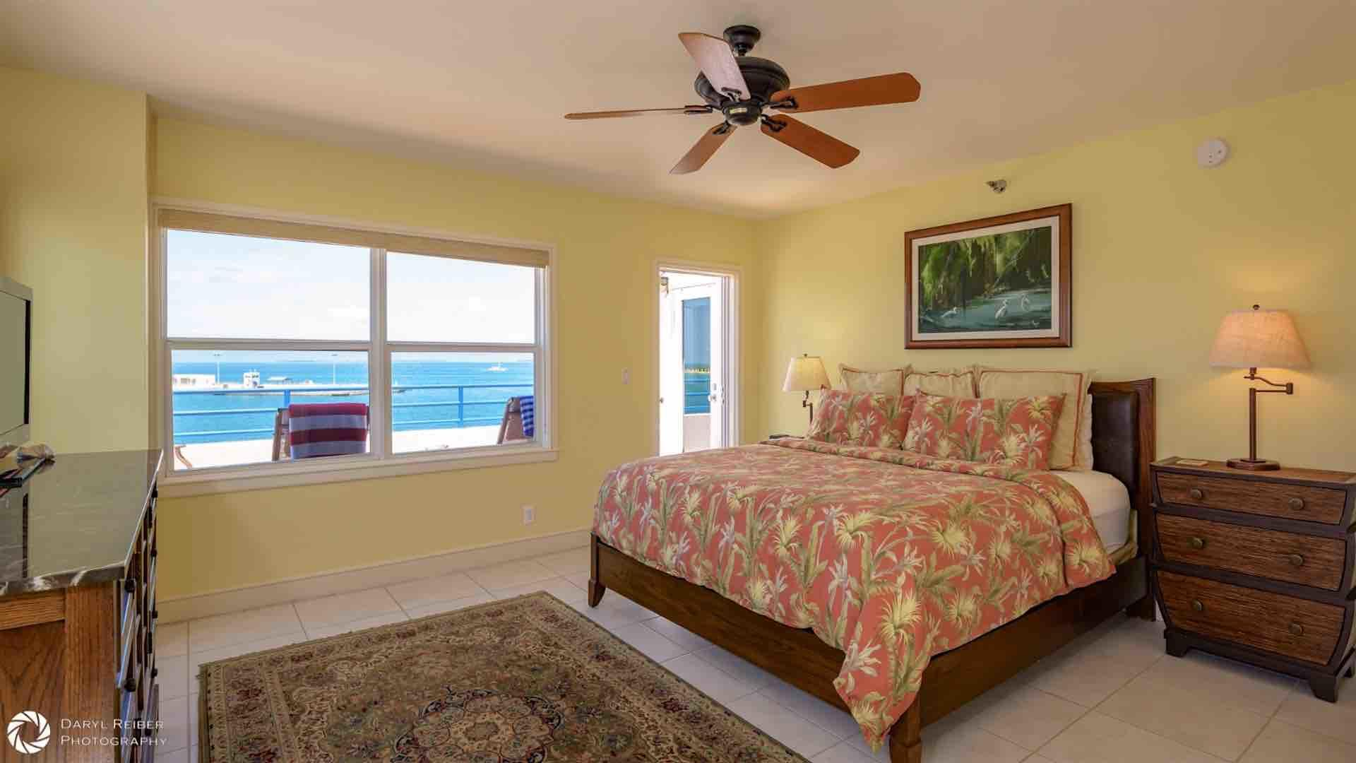The master bedroom has a King bed and balcony access...