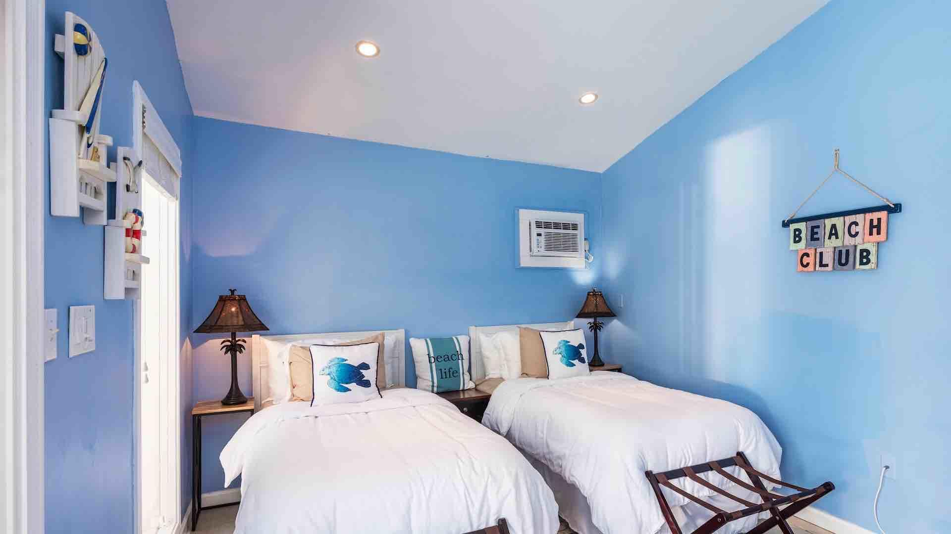 The guest house has two twin beds that can convert to a King bed...