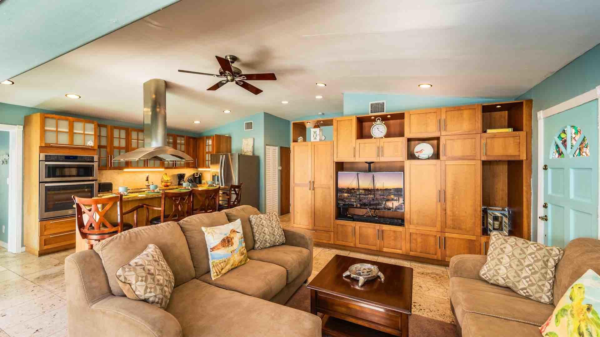 The living room has a large flat screen TV and plenty of seating for everyone...