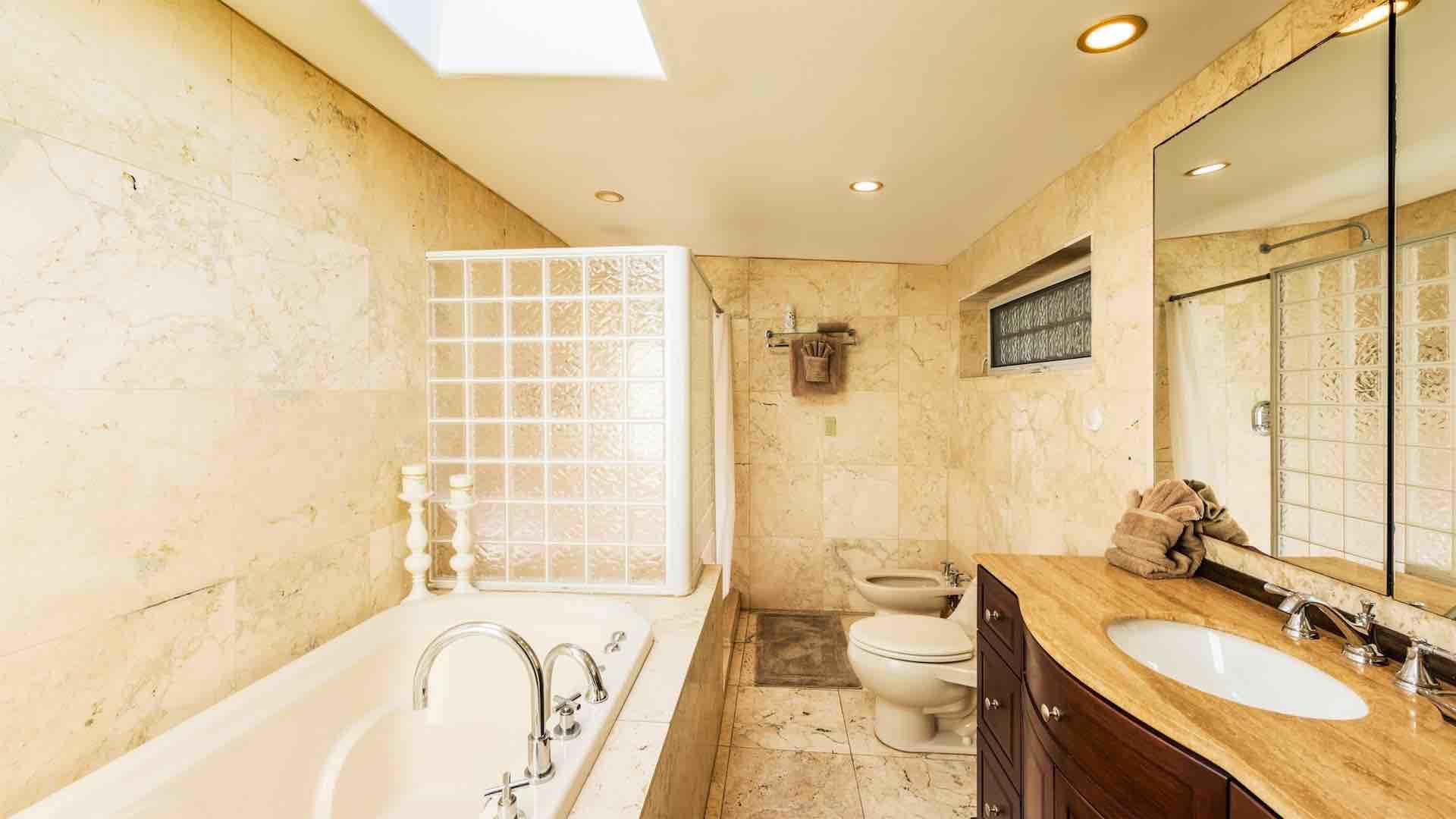 The second master bathroom is en suite, with a tub and a shower...