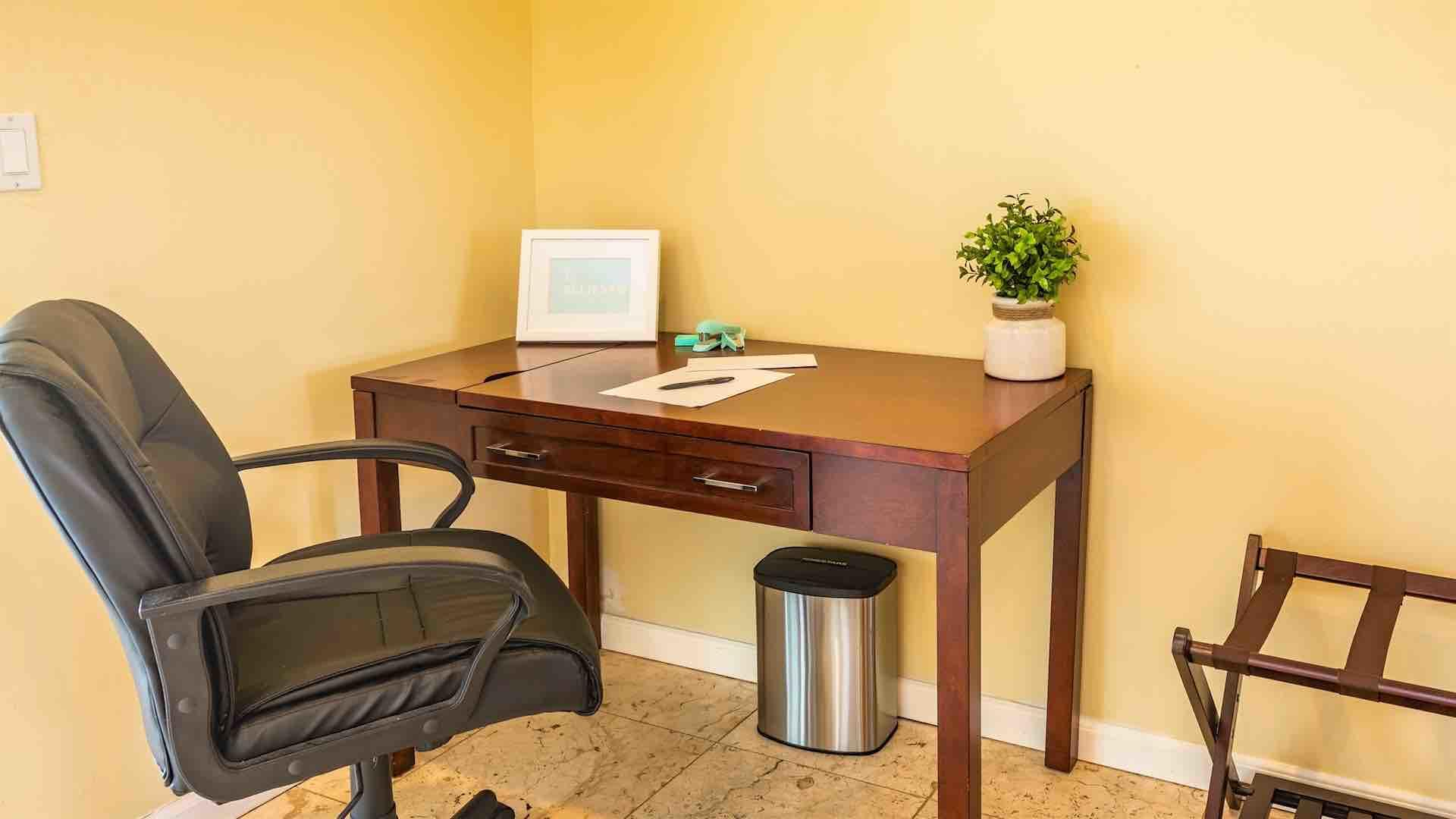 The second master suite has a home office with a desk and chair...