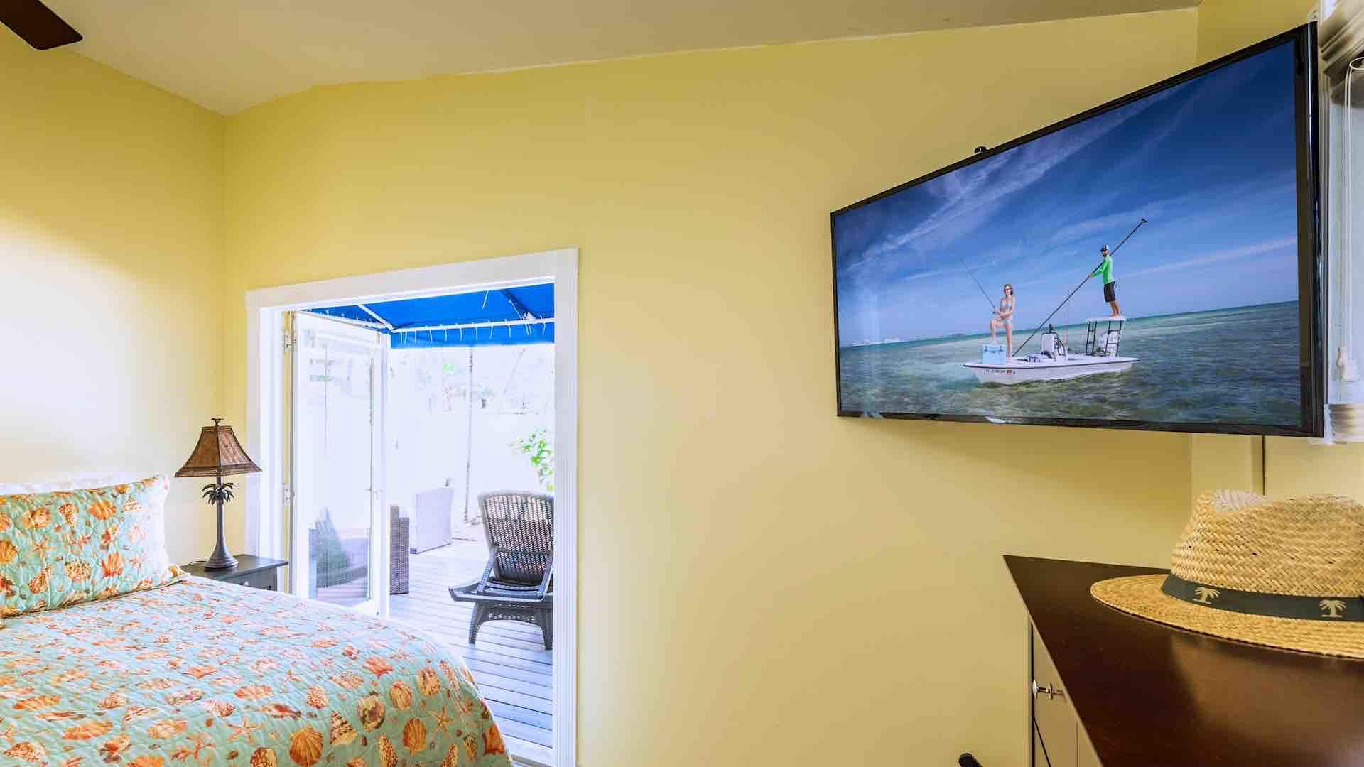 The first master suite has a large flat screen TV...