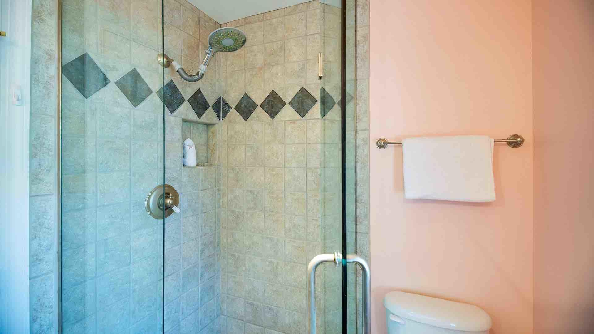 The second master bathroom also features a custom frameless glass shower...