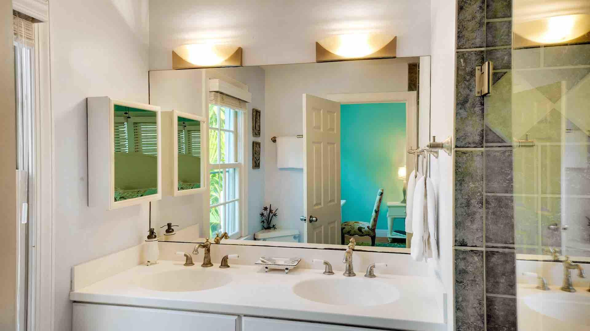 The first master bedroom has an ensuite bathroom with twin vanities...