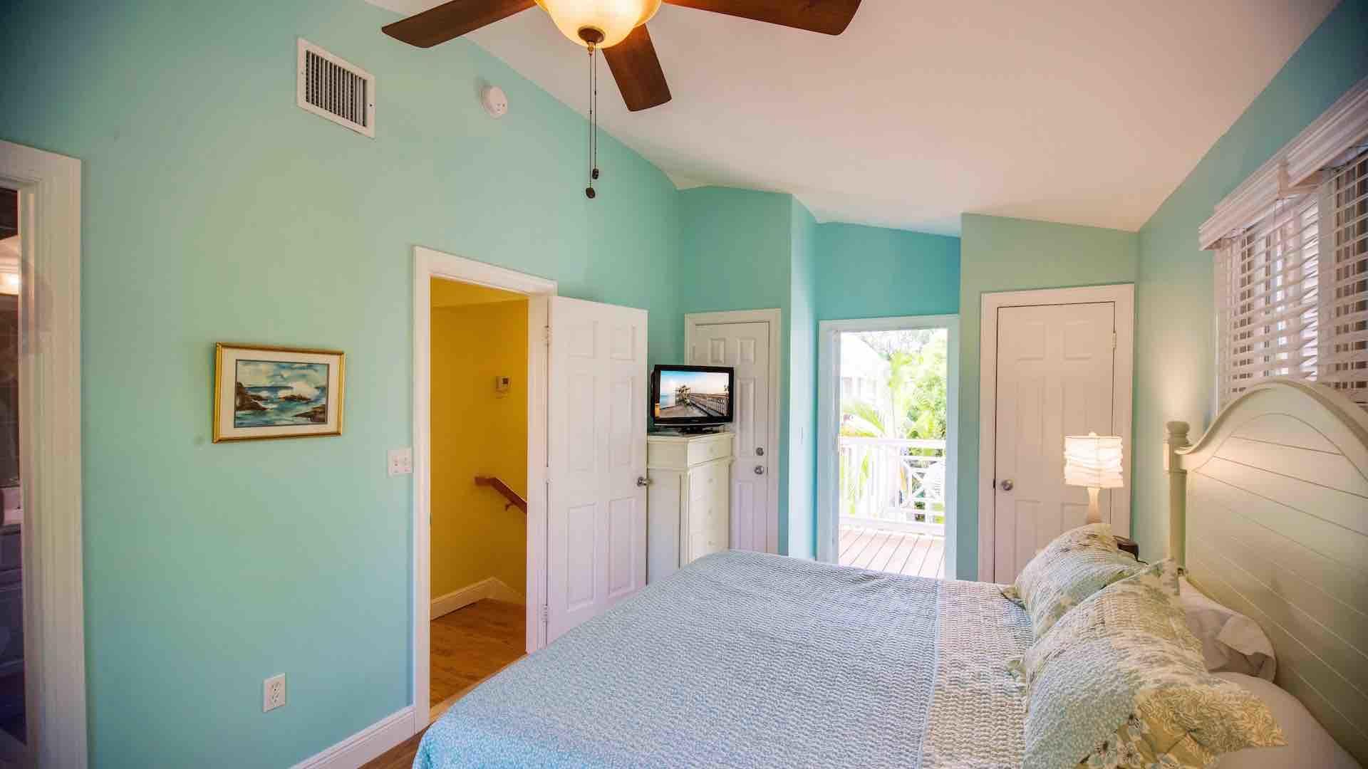 The first master bedroom features a king bed and includes a flat screen TV...