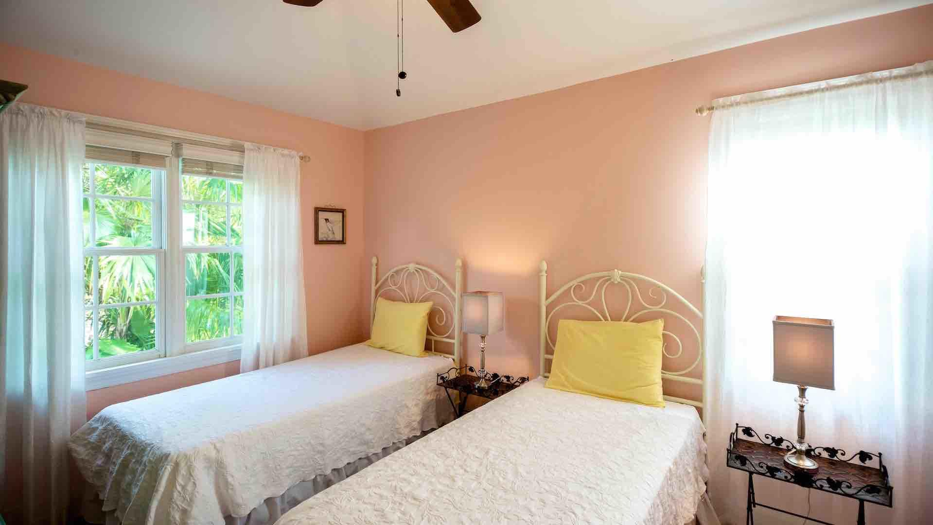 The second master bedroom has two twin beds that convert to king bed on request...