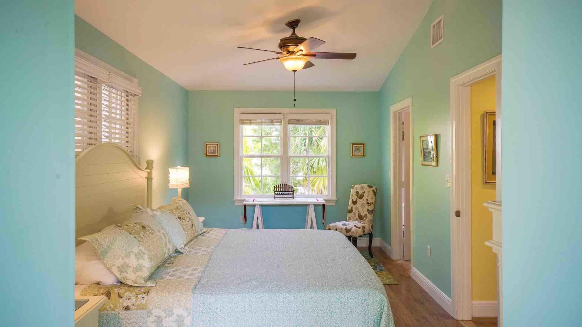 The first master bedroom has a vaulted ceiling and desk space...