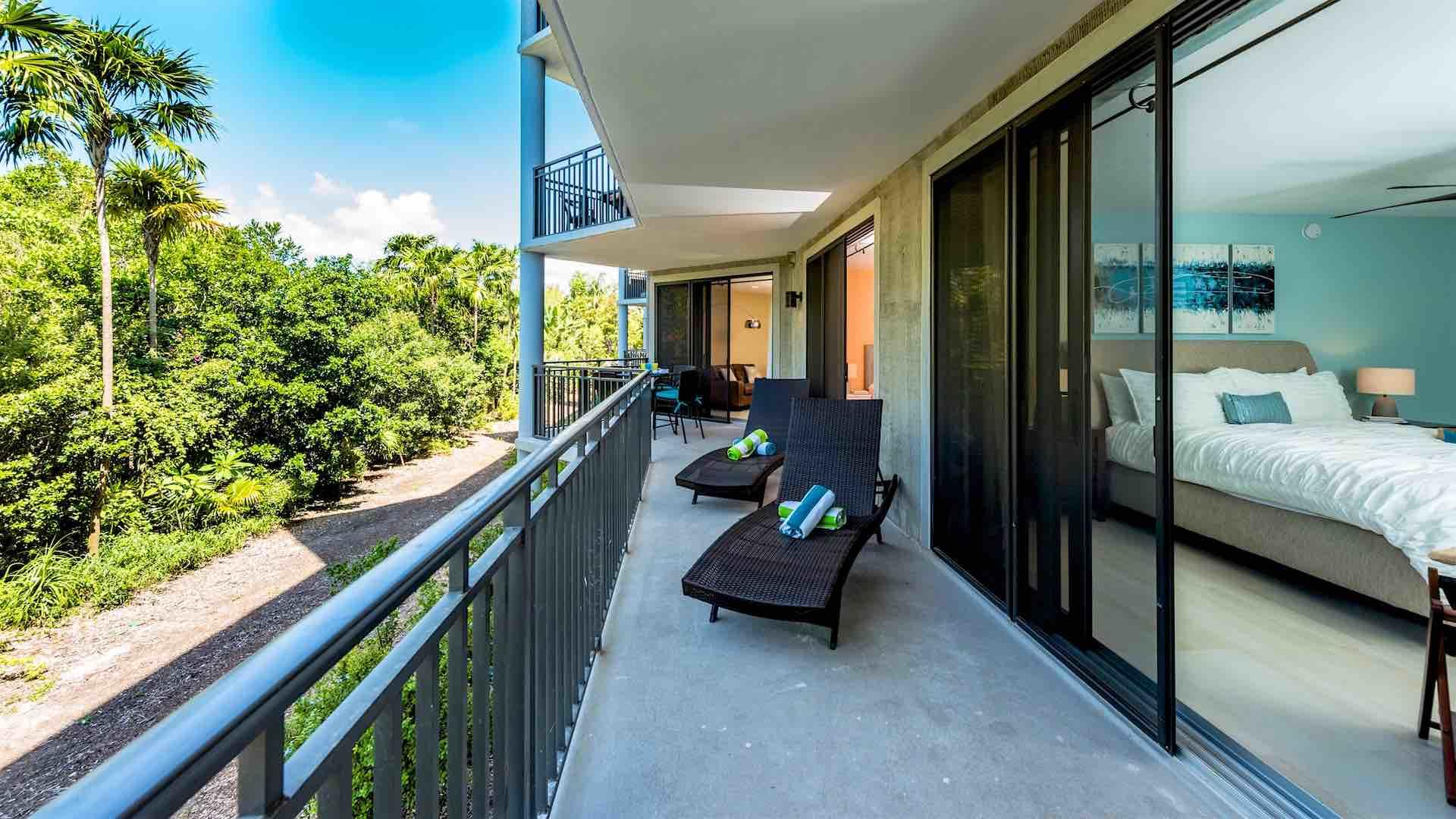 There are two chaise lounges on the spacious balcony...