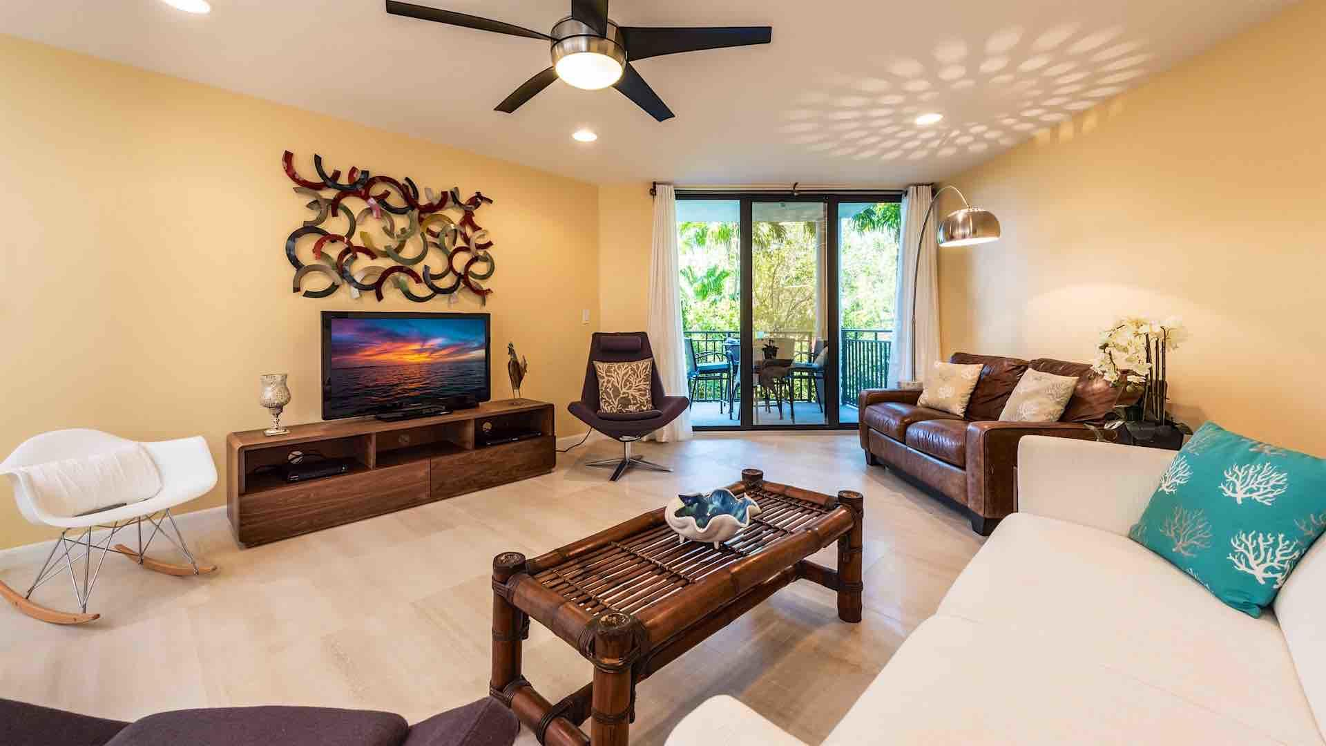 The living room has a large flat screen TV and plenty of comfortable seating...