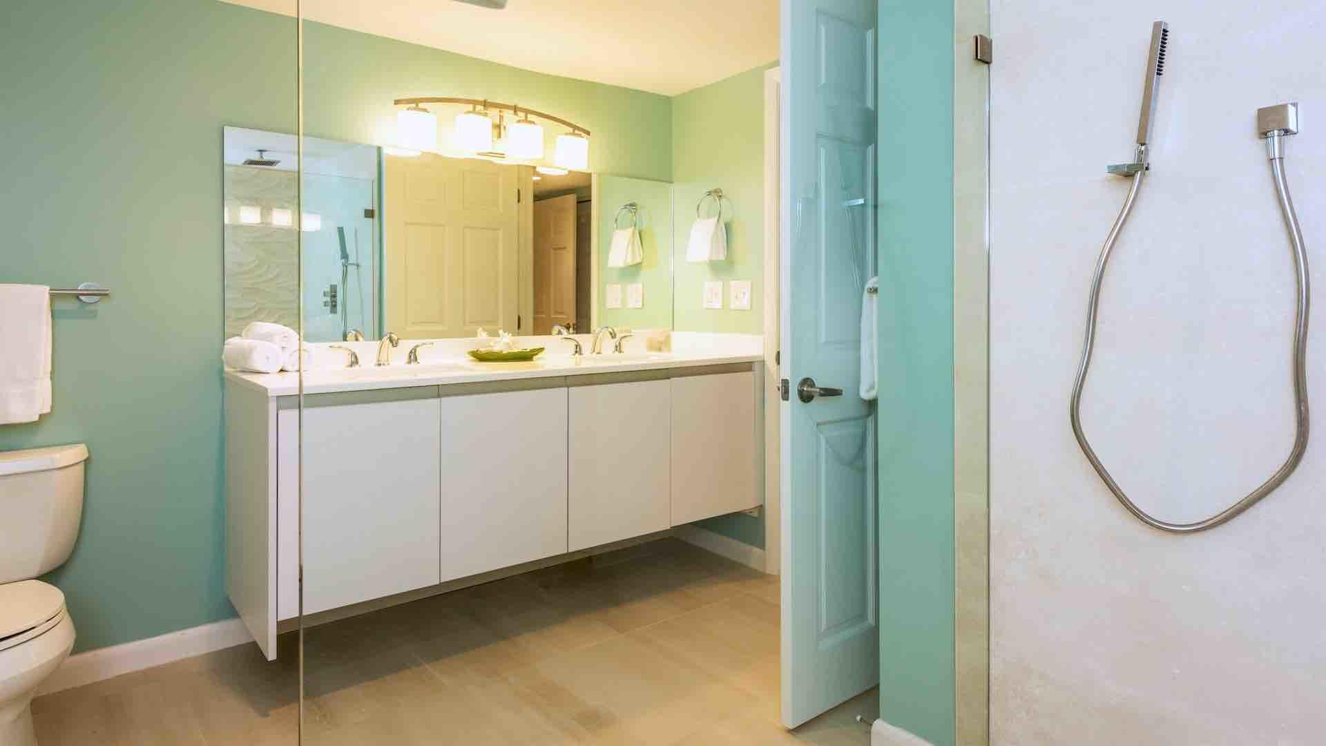 The master bathroom also has a large walk-in glass shower...